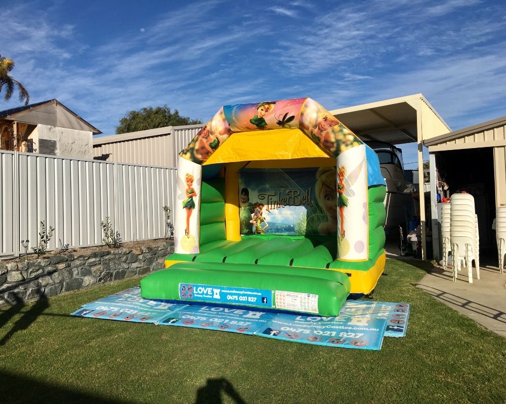 Tinkerbell Bouncy Castle Set Up For A 1st birthday in Rockingham