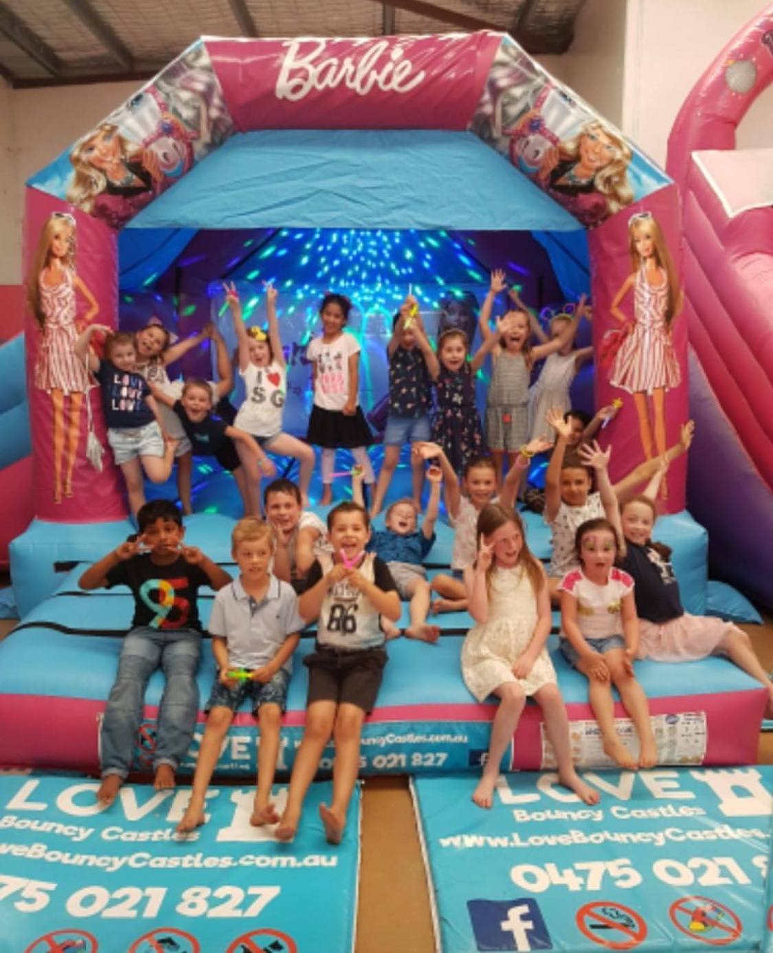 Copy of Kids Party With Children Playing On A Barbie Bouncy Castle That Was Hired Out In Perth