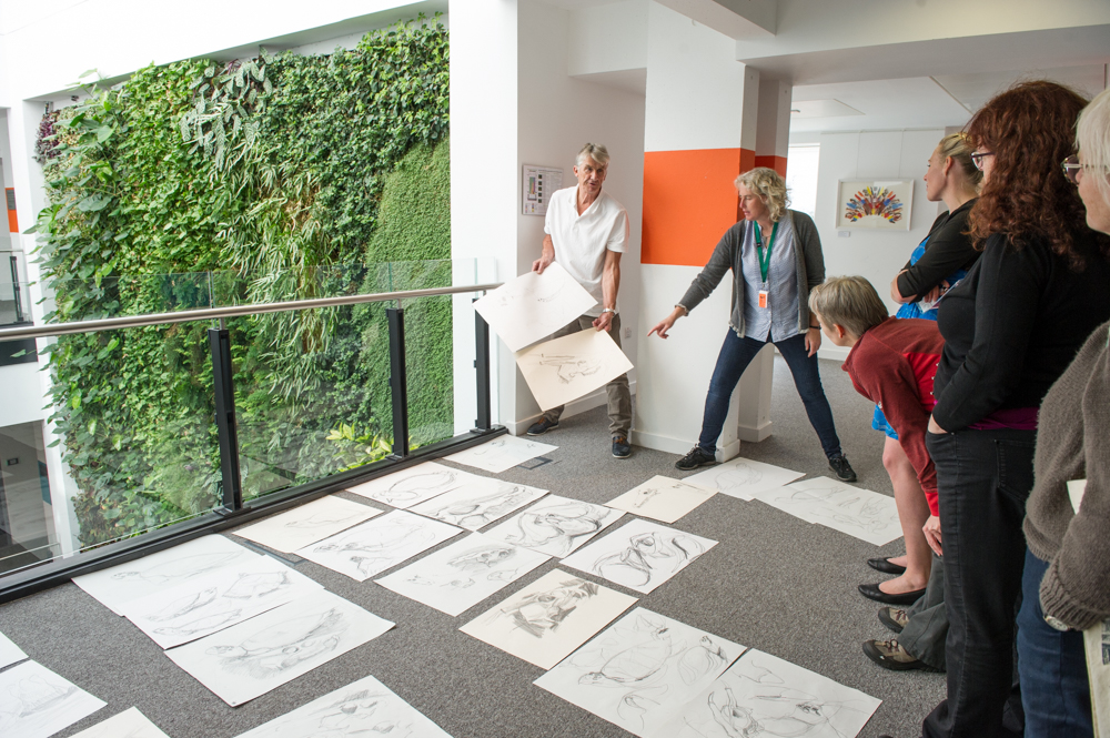 Bruce Pearson and Harriet Mead discuss people's drawings © Cheryl-Samantha Owen