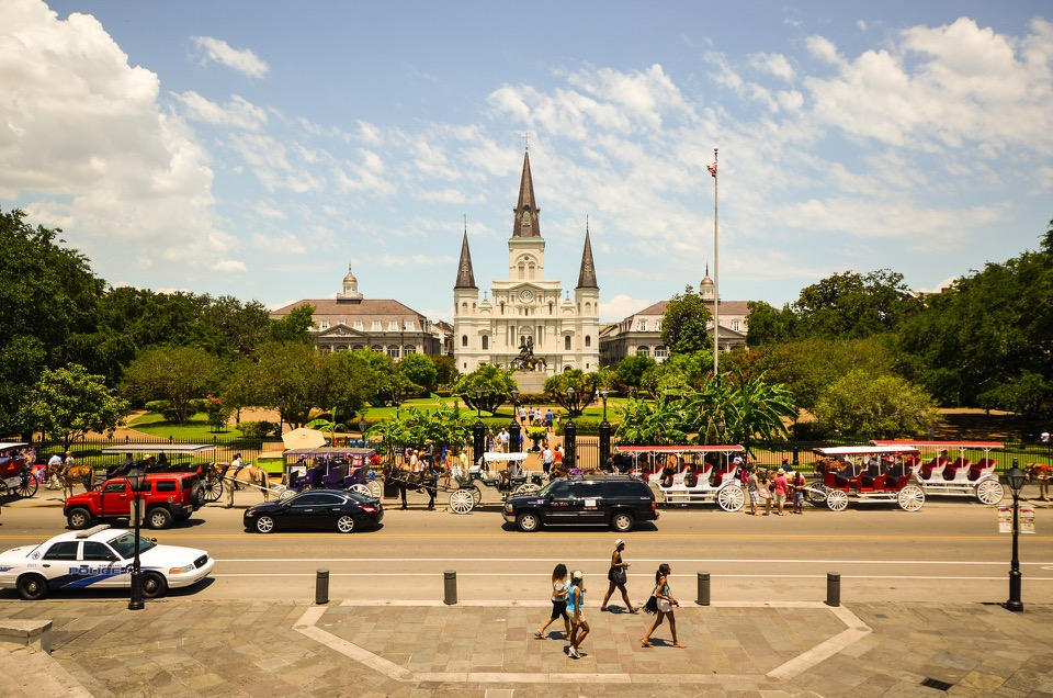 Jackson Square: (Center) St. Louis Cathedral, (left) the historic Spanish-Colonial  Cabildo