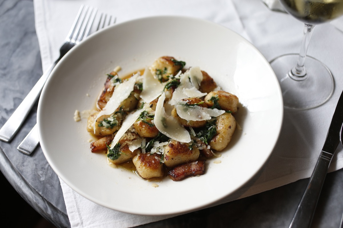 Left to Right: Herbsaint Gnocchi, Herbsaint's Dining Room (photo credit: Link Restaurant Group)