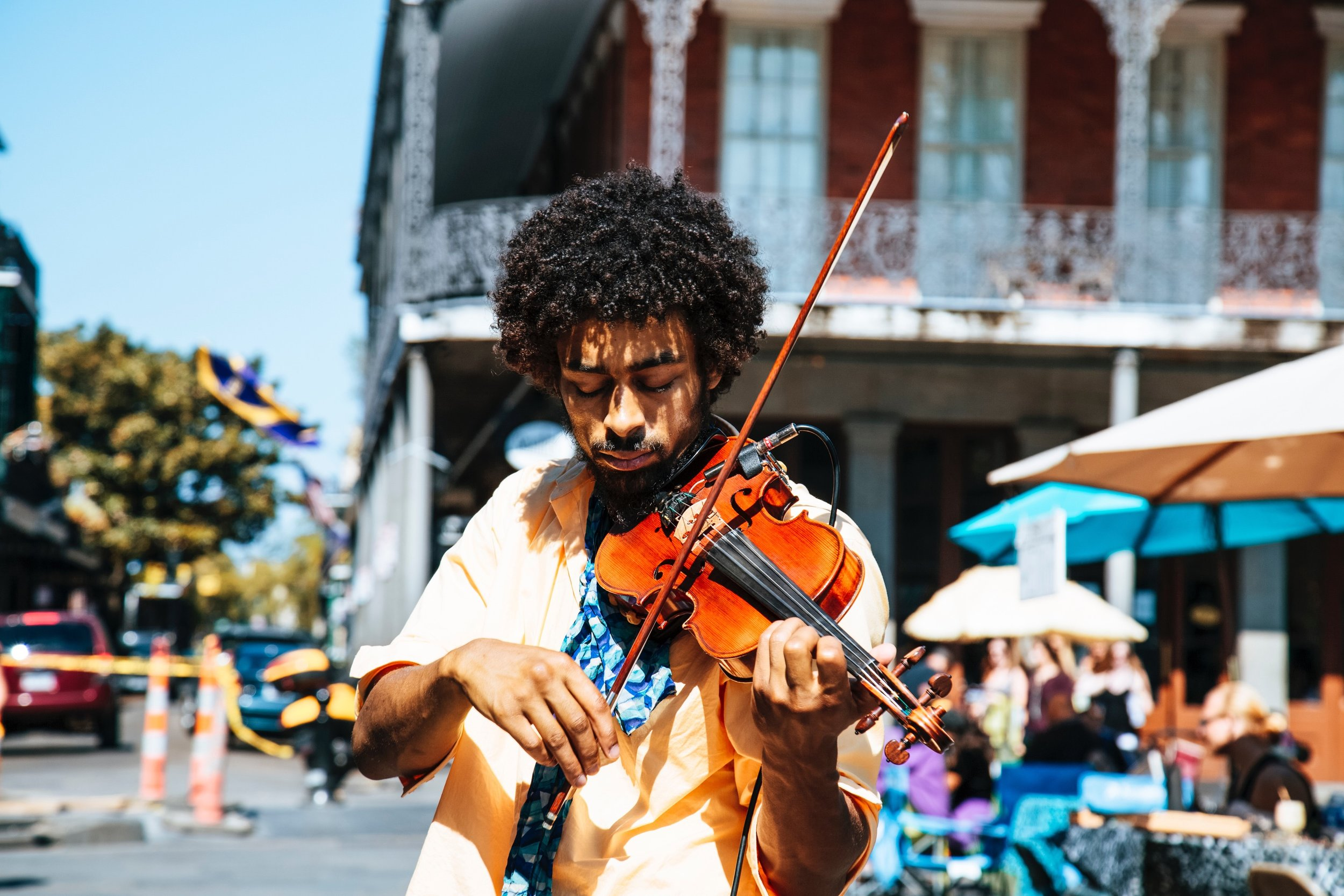 Left to Right: Live Music on the Streets of New Orleans (photo: William Recinos), Sunset over the Mississippi