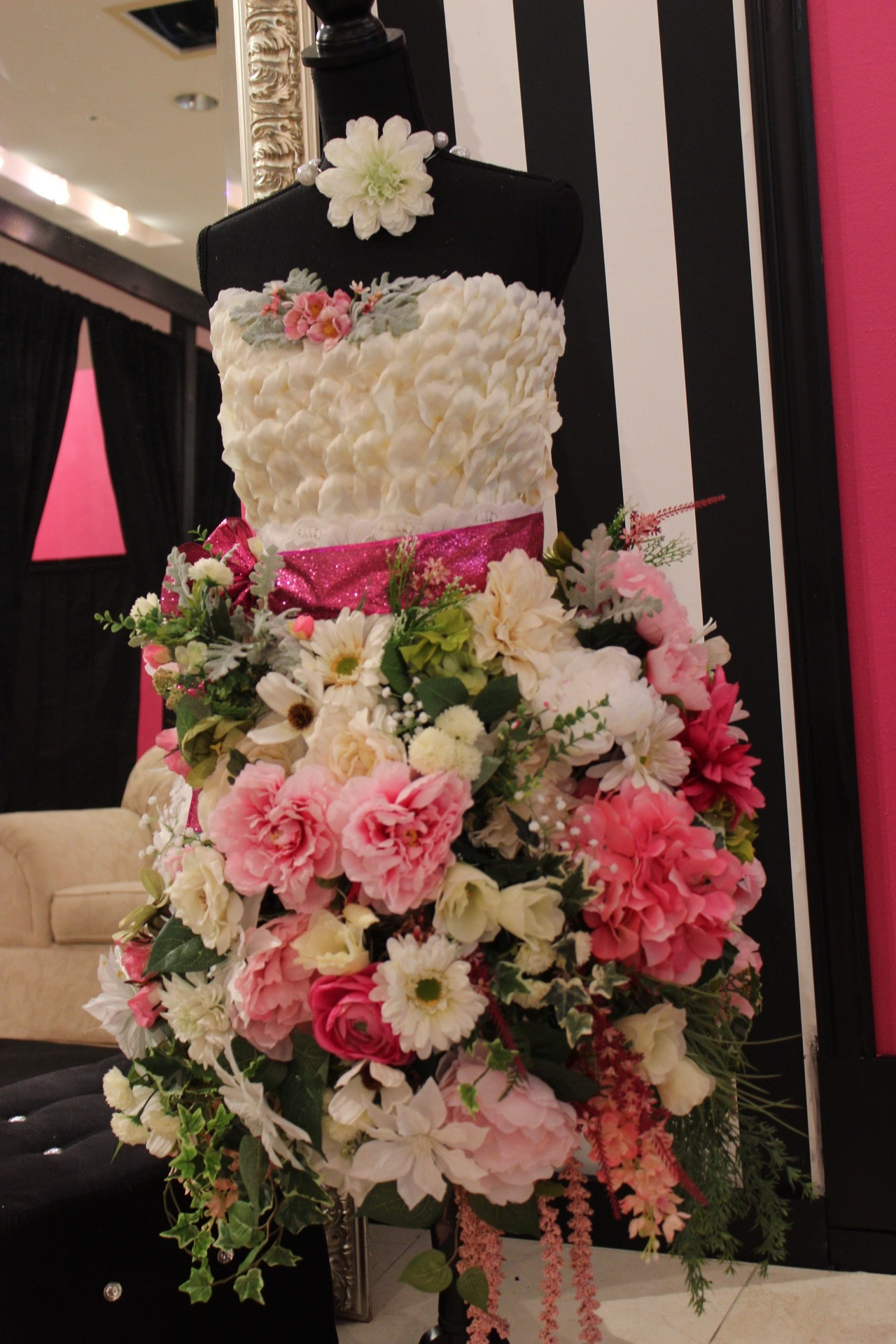We're obsessed with this floral arrangement that was made to look like a dress. It was perfect for the occasion!