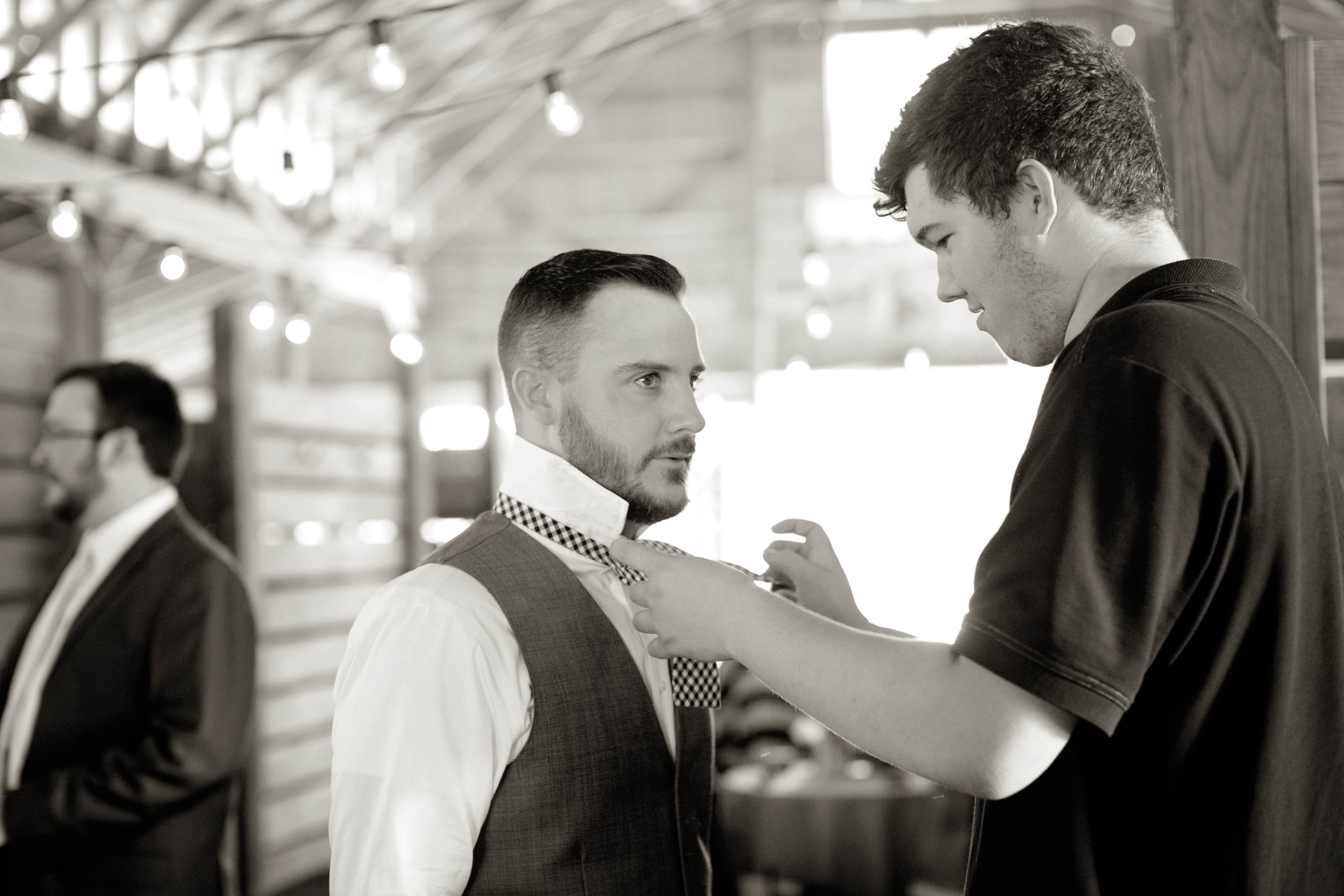 My Son Nate took a break from setting up to tie Jeff's bowtie :)