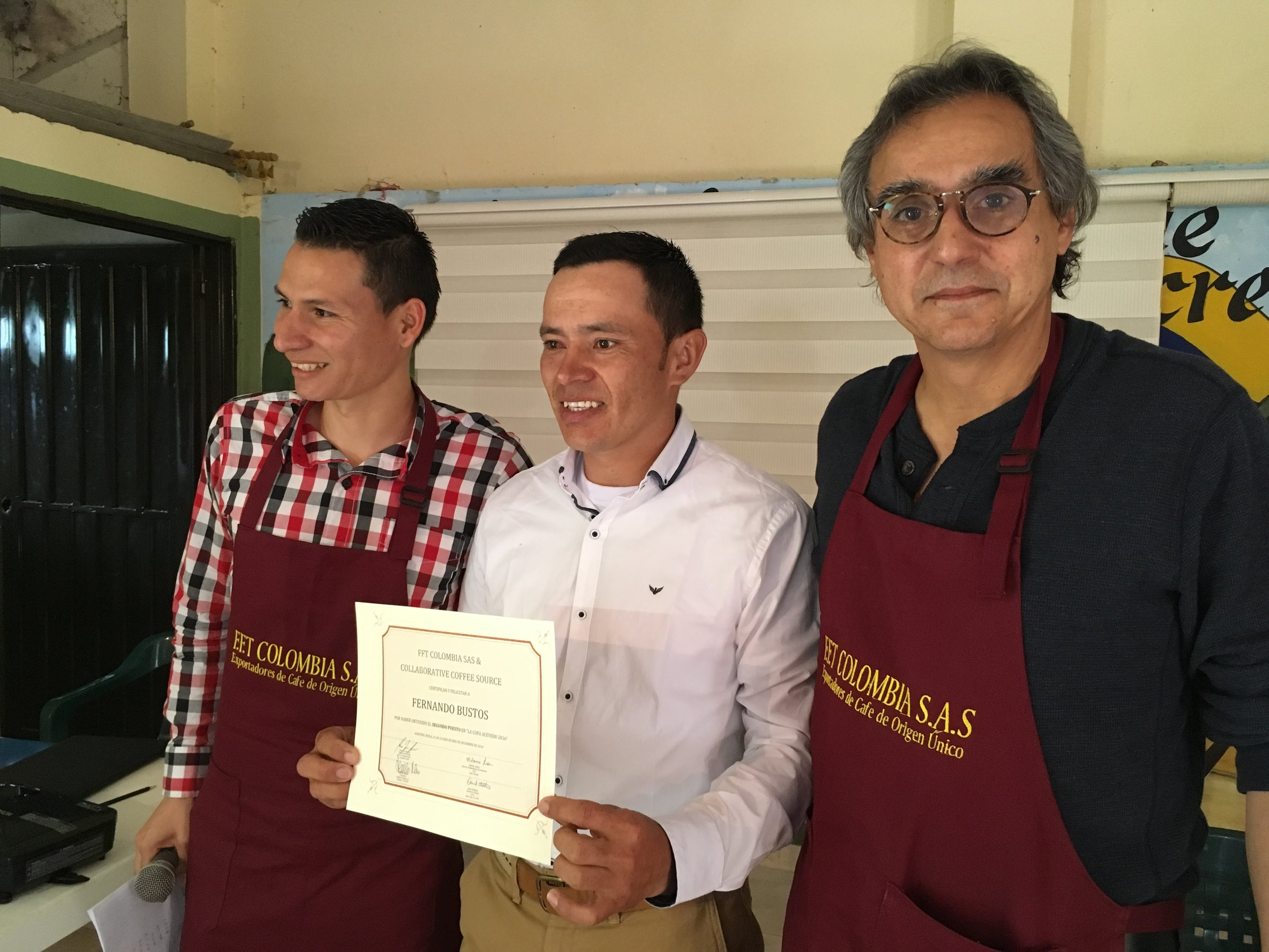 Left to right Eduardo Urquina of Fairfield Trading, Miller Bustos collecting the certificate for his brother Fernando Bustos, and Alejandro Renjifo of Fairfield Trading.