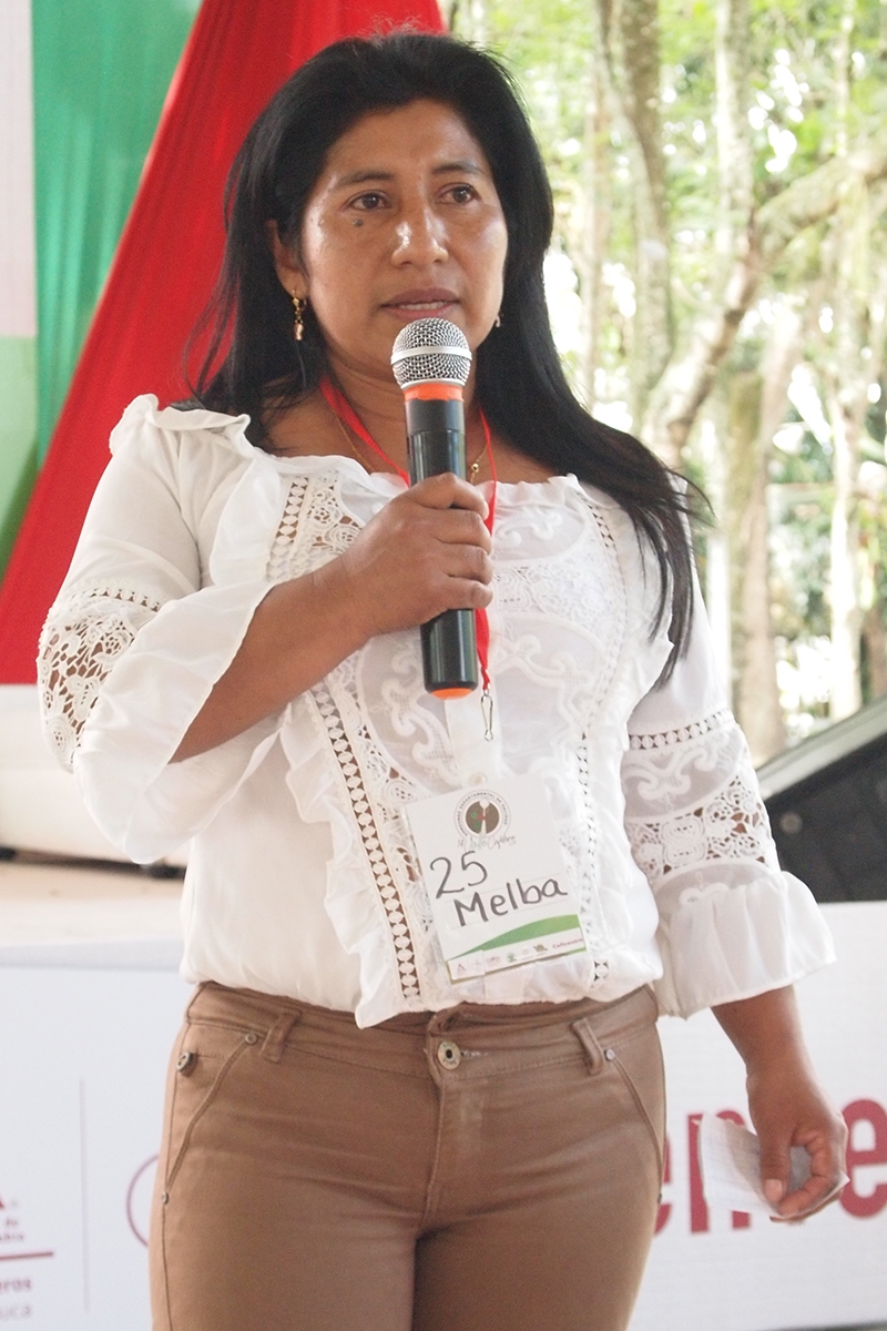 Melba Guainás Bubú, indigenous producer from Florida, Valle del Cauca, presents her coffee during the Business Round. Melba's coffee placed third in the Valle Cafetero competition, 2018.