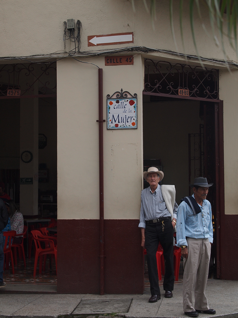 "Men wait on ""Women's Street"" in Caicedonia, Valle del Cauca."