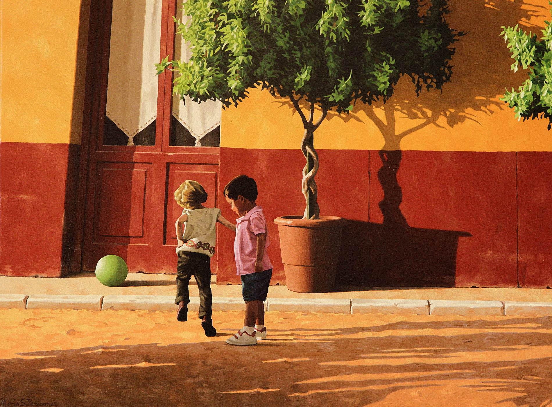 Deux enfants et ballon vert
