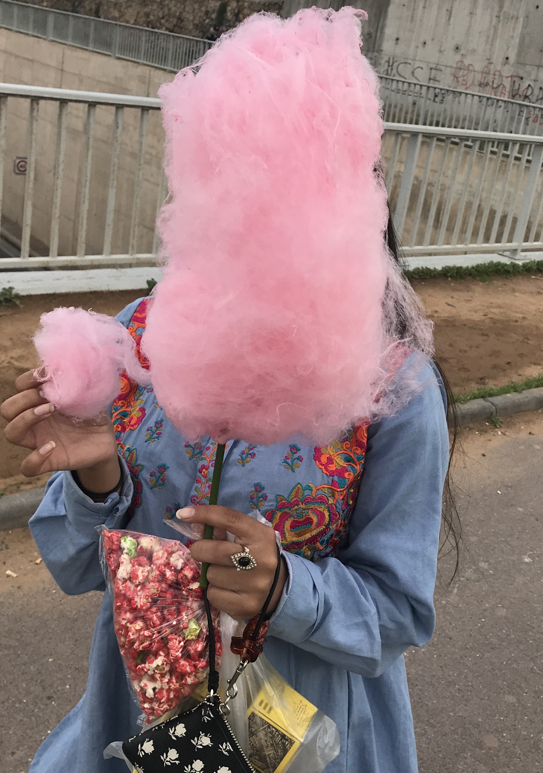 Enjoying cotton candy! Photo Credit: Ammarah Rehman, 2018.