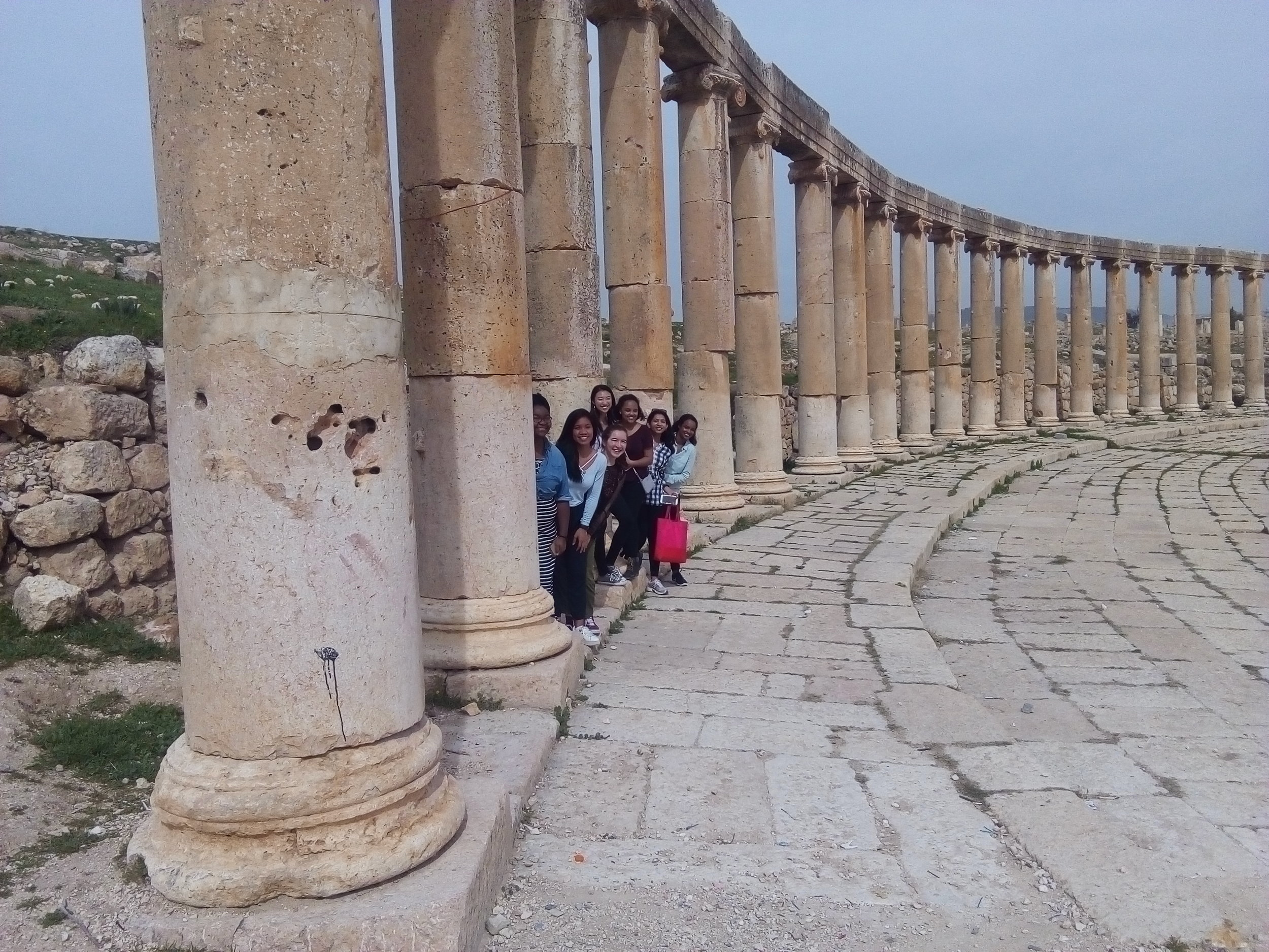 Spring 2018 students pose in the ruins of the Temple of Zeus at Jerash, one of the Roman Decapolis cities, during their Northern Excursion.