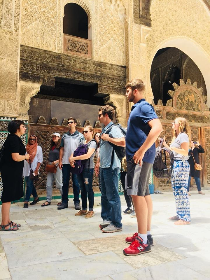 Students touring one of the ancient schools of Fez. Photo Credit: AMIDEAST, 2018