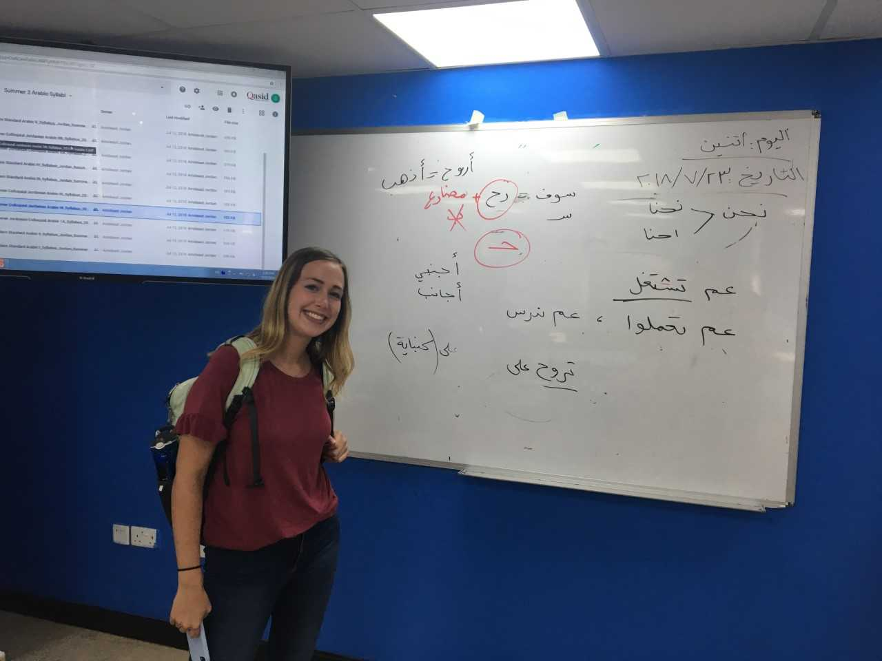 My classmate, Hannah, poses by the Ammiya board after class. Photo credit: Russ, 2018