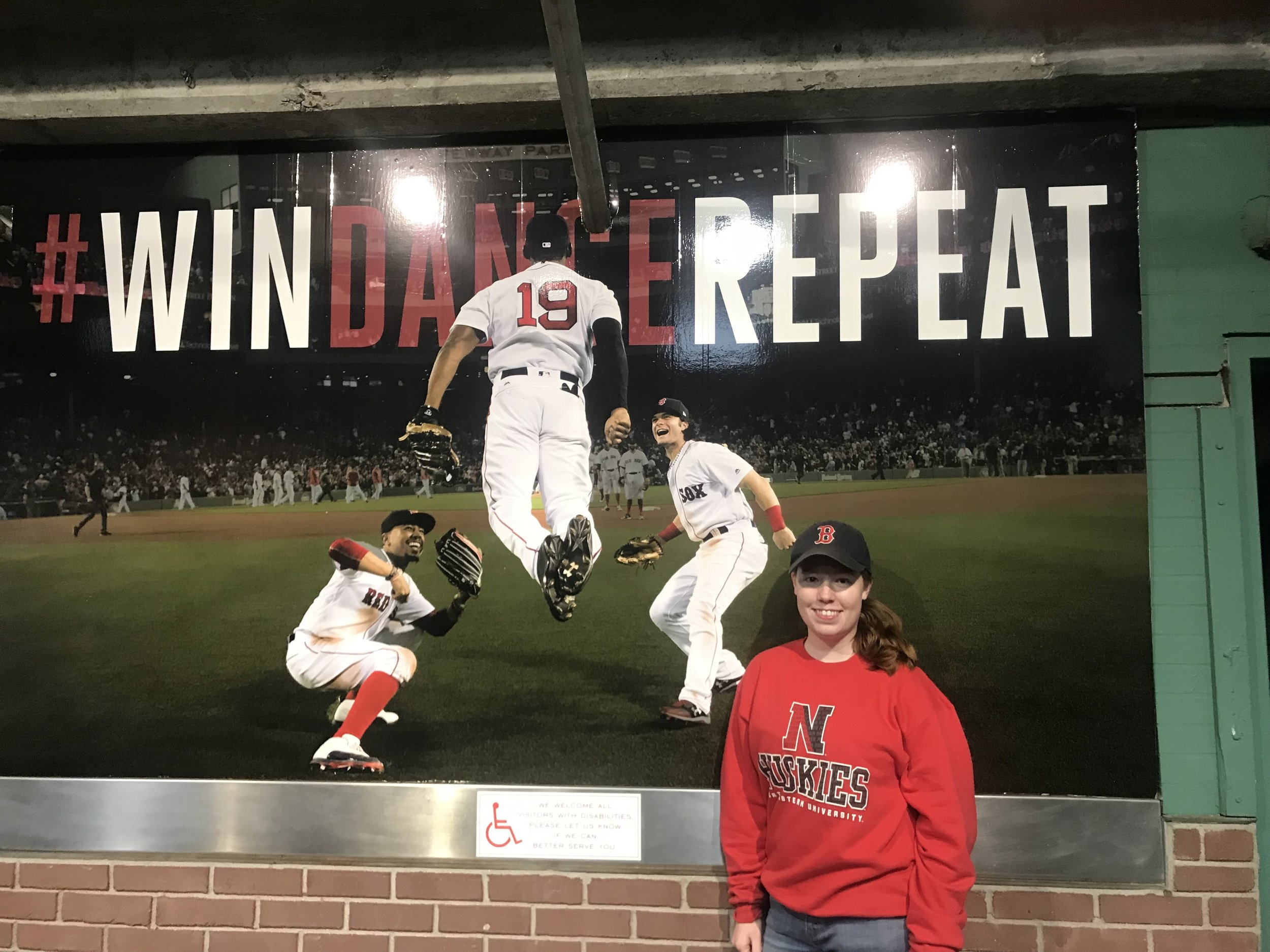 """My name is Ciara Tenney and I go to Northeastern University in Boston, Massachusetts with a major in Criminal Justice and a minor in Arabic Language. In this photo, I am at a Red Sox baseball game in September 2017 on the day the Red Sox clinched the American League East Division. This game was special to me because I attended it with my father who came down to visit me in Boston just for the game and I got to see my beloved Red Sox celebrate their victory. While I go to school in Boston, I grab """"Student 9's"""" tickets as often as possible to go to games at Fenway Park for only $9. Photo credit: Tenney, 2017."""