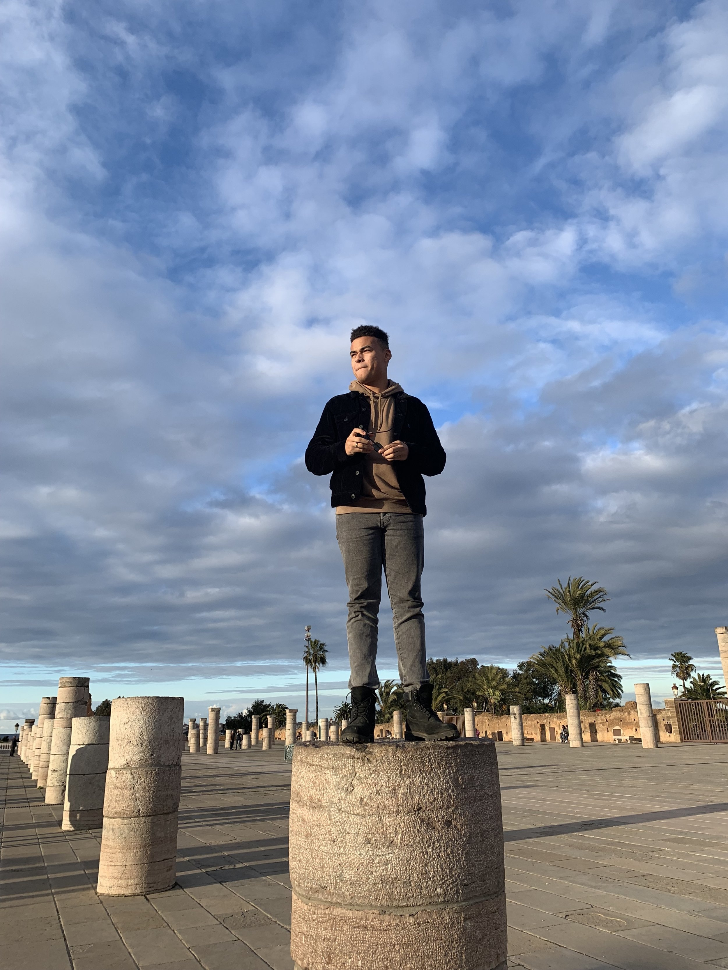 Locals and tourists, including myself, take it upon themselves to snag pictures atop one of the many pillars that line the mausoleum courtyard. Photo Credit: M. Aboko-Cole, Spring 2019.
