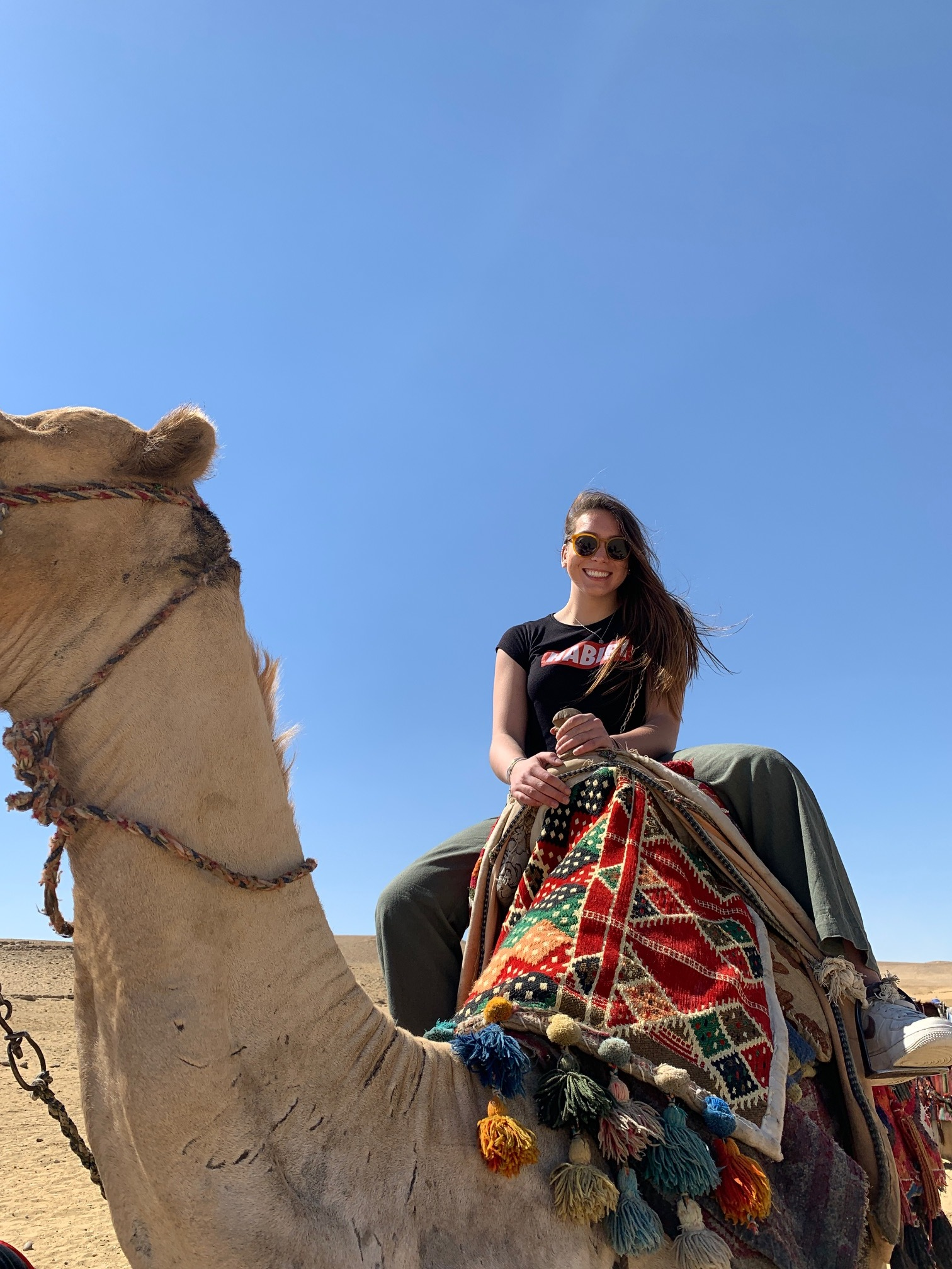 Of course we rode camels! Photo credit: Arguin, 2019