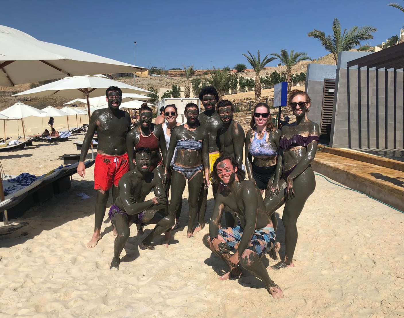 We had so much fun with the Dead Sea mud. Photo credit: Arguin, 2019