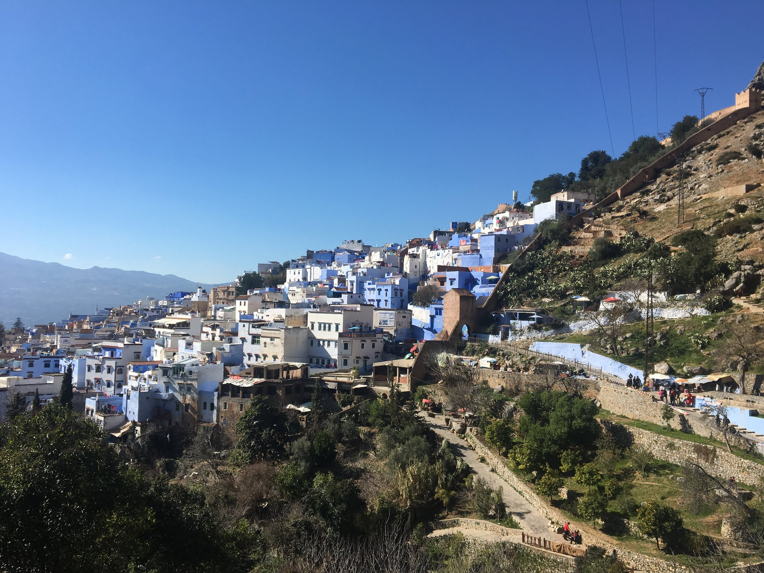 Chefchaouen, the blue city, looks like it was carved into the very mountains themselves. The blue medina that attracts so many tourists is calming and tranquil. Hiking up to the Spanish mosque to catch a glimpse of the view, Chefchaouen does not disappoint at any angle. Photo credit: Fisher, 2019