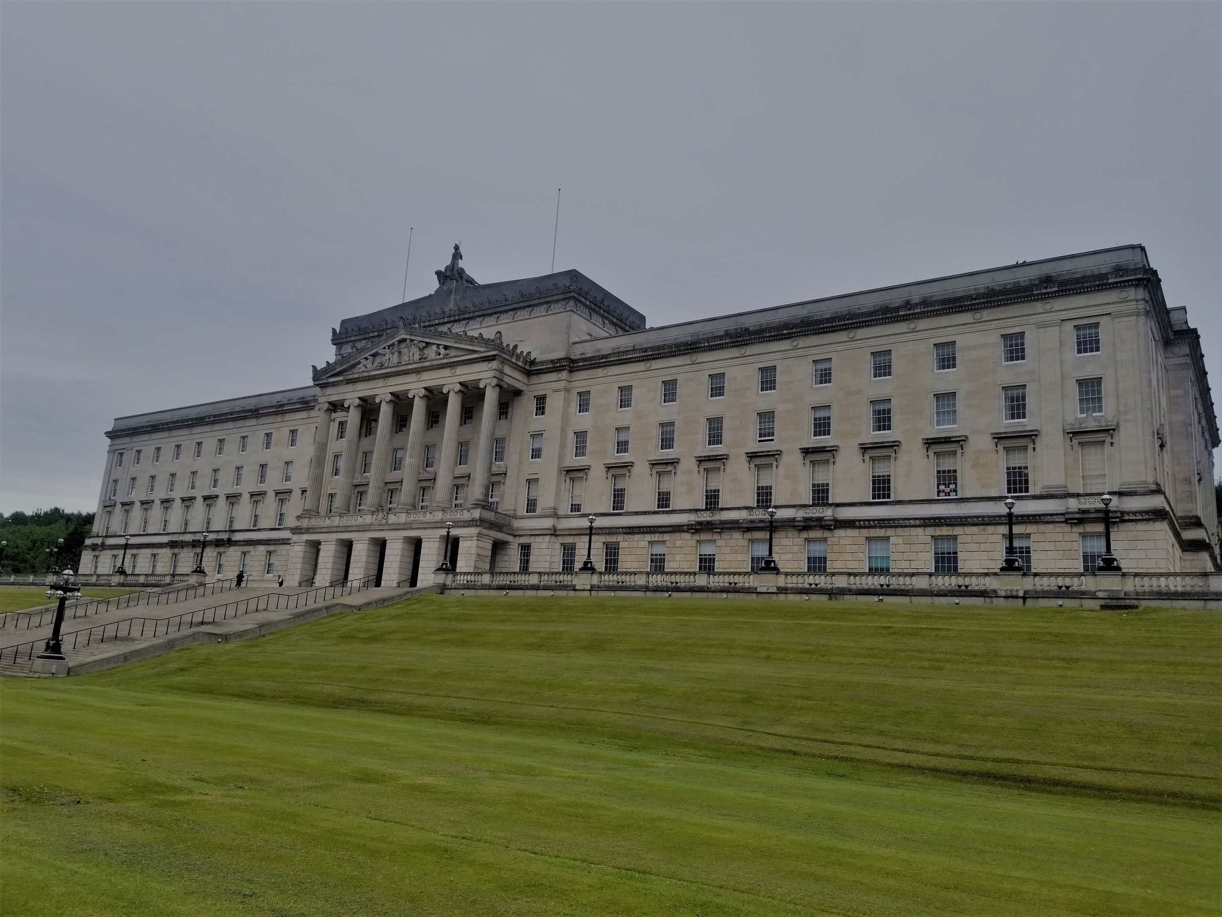 A government building for the six counties of Northern Ireland, Stormont has many symbolic pieces throughout, and is situated in a quiet, beautiful part of Belfast. Photo credit: Morrill, 2019