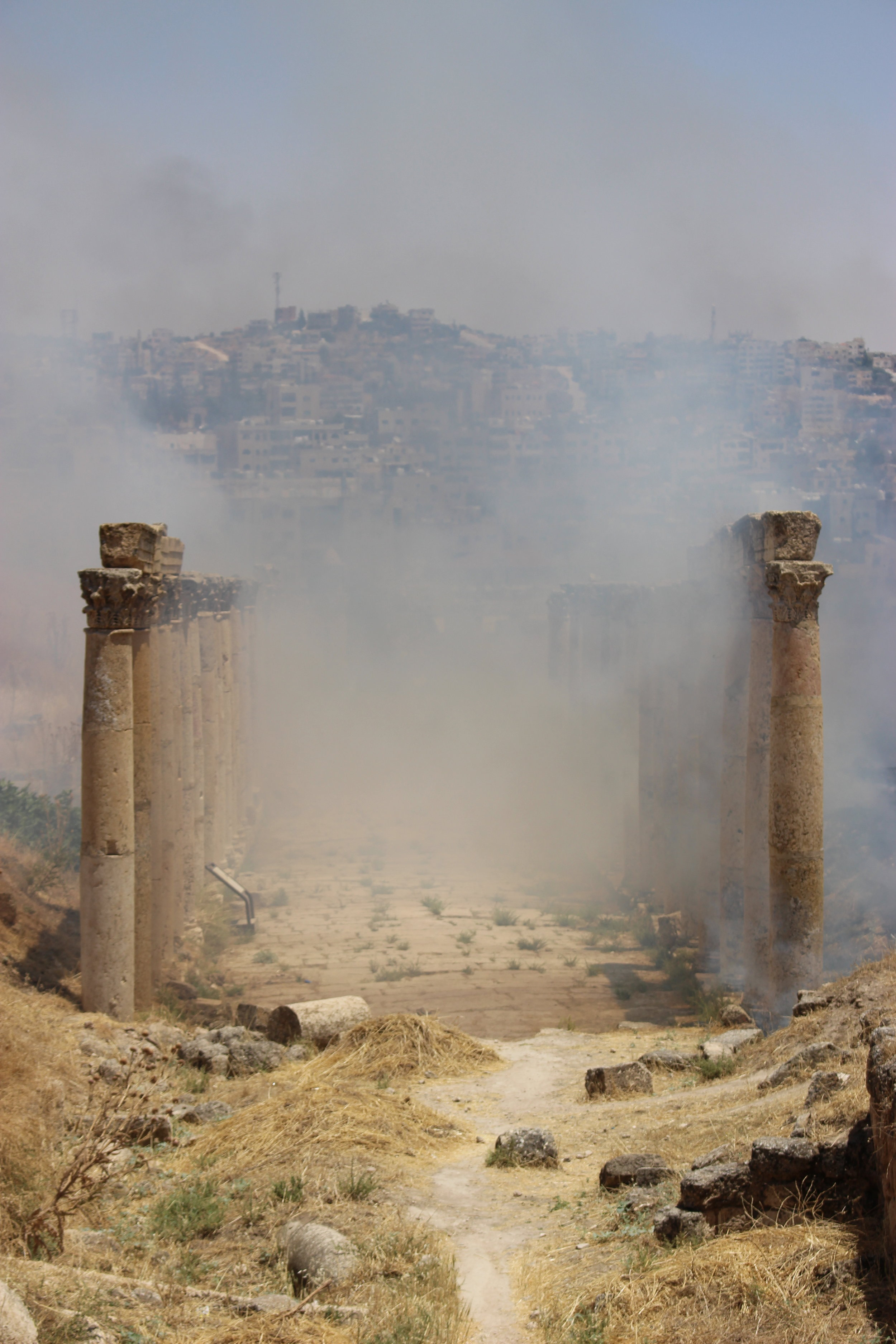 From a distance, the crackling of flames announced billowing columns of smoke. The plumes issued from Jerash's Decamanus, the old east-west Roman road. Photo credit: Jessen, 2019