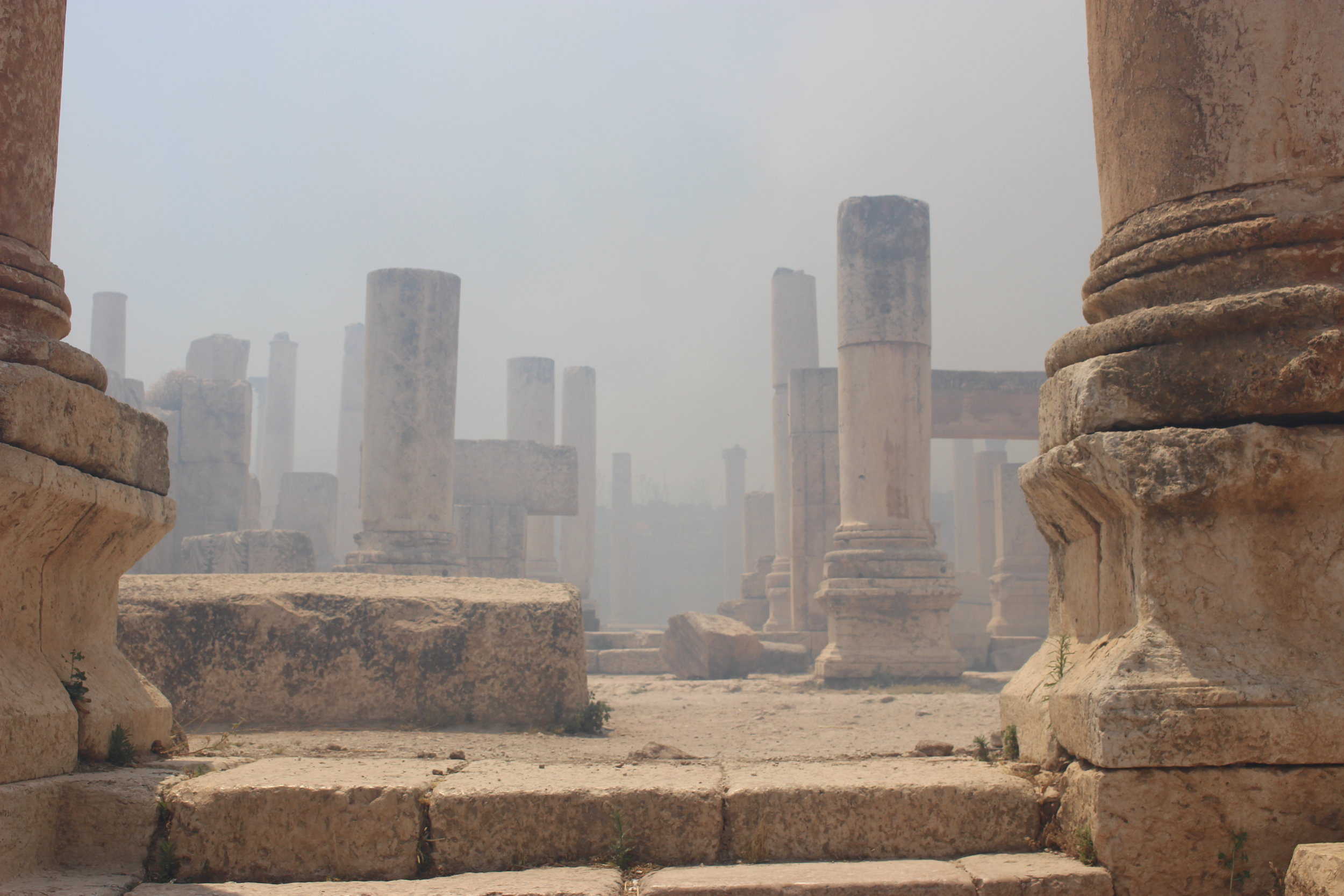 Smoke drifts eerily among the columns of an old Byzantine church. I half expected djin to emerge from the cloistered stones. Photo credit: Jessen, 2019