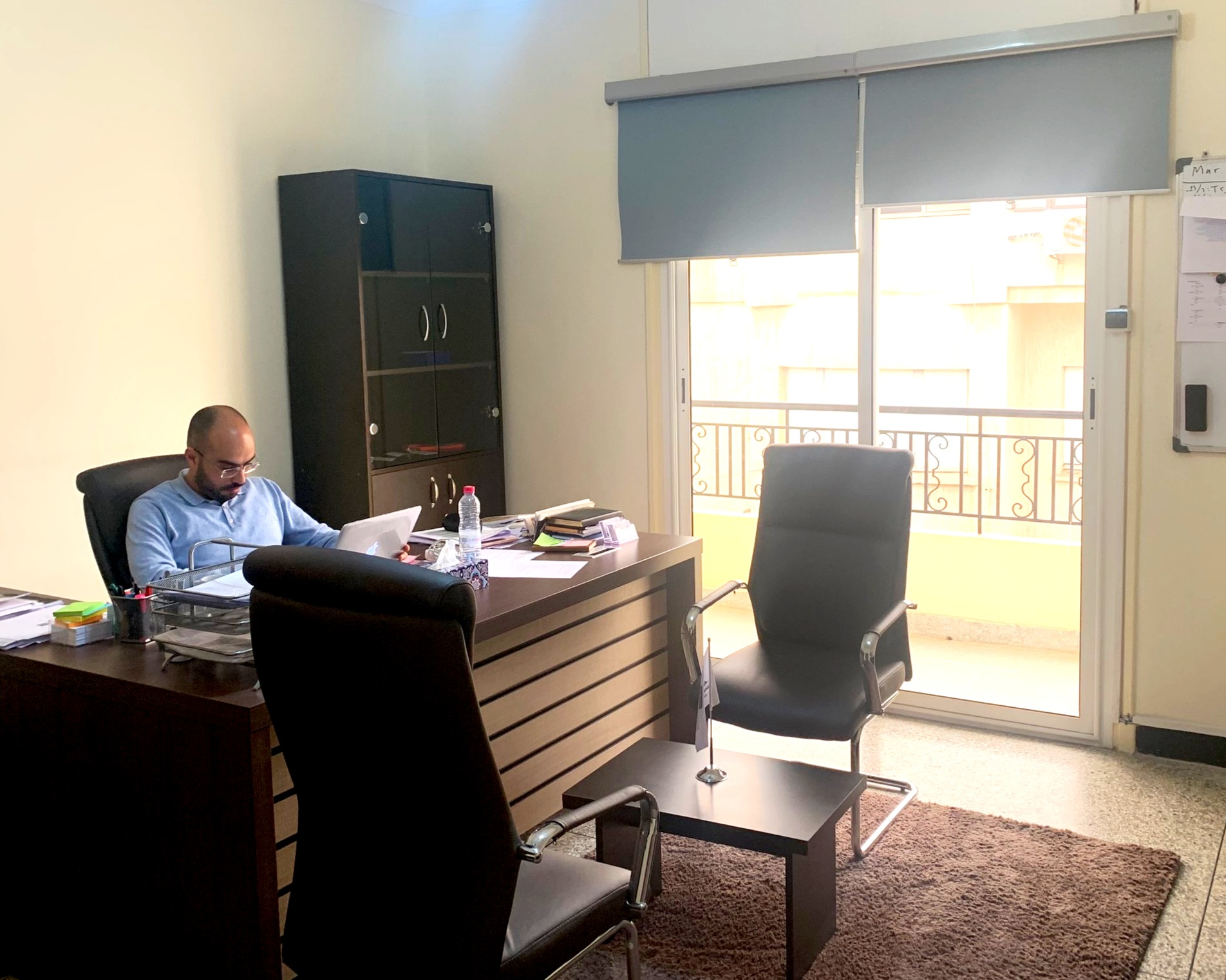 Director Mohammed Masbah hard at work in his office. Photo credit: Aboko-Cole, 2019