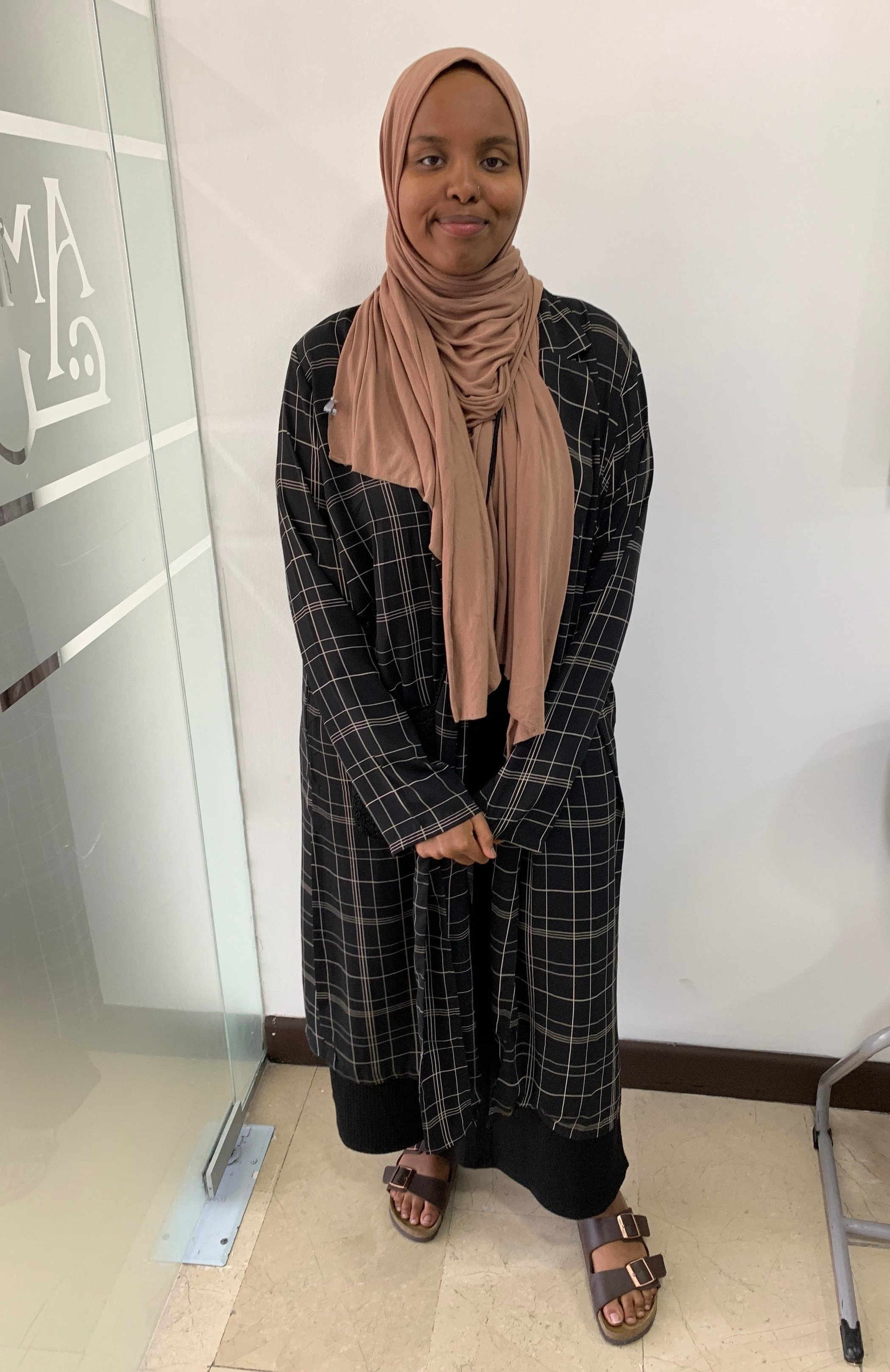 If you wear a hijab, one thing that I have noticed a lot of Jordanian women do is do all black and a colorful headscarf. It is very easy to do and that pop of color is very nice. Again it's all about staples here. What can you wear more than once and on different occasions? Here my friend also does a wonderful job of layering. You can see her long jacket; that is a great way to cover perhaps a shirt with no sleeves or just to spice up an outfit. Honestly obsessed with this friend's style. Photo credit: Jones, 2019