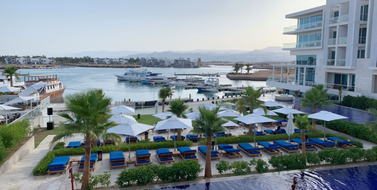 Aqaba was HOT. Walking outside meant immediate sweat. Even the breeze was warm! Therefore, the first thing we did after exploring the hotel was go to the pool. This pool was gigantic, and it looked onto the Red Sea. I could have stayed there forever! Photo credit: Moriarty, 2019
