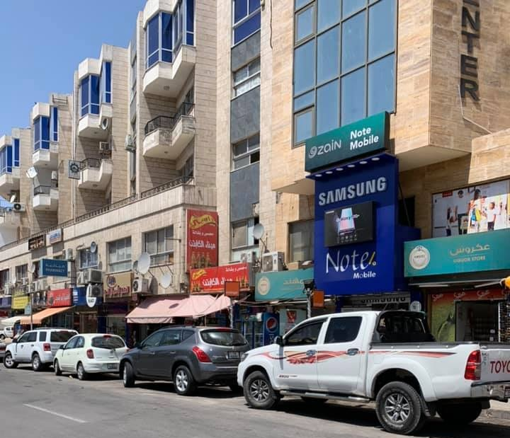 When we were done snorkeling, we drove back through the city center and I was surprised to see how similar this area seemed to Amman, with the cafes, cell phone providers, and indoor-outdoor markets. Photo credit: Moriarty, 2019