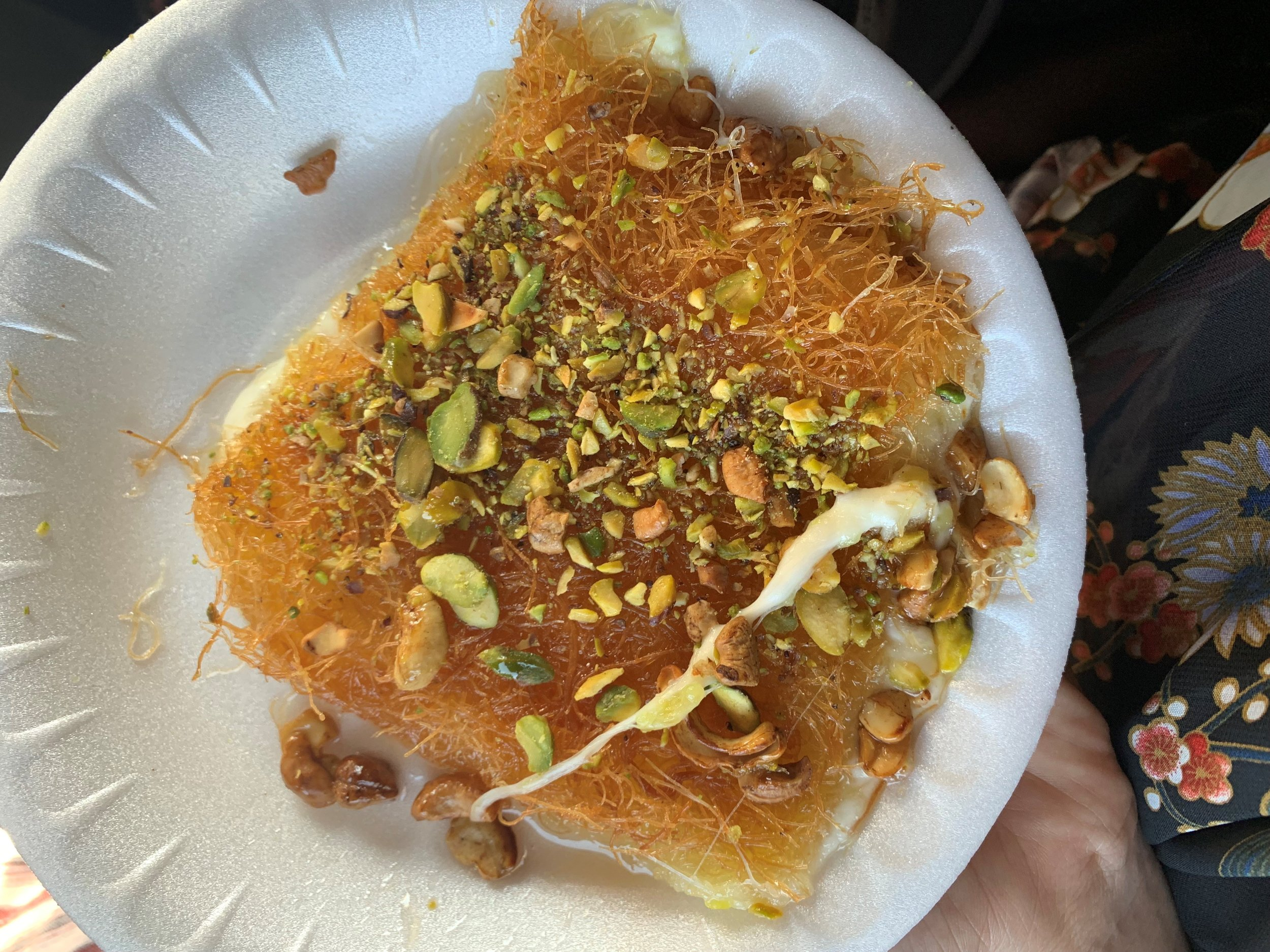Not the most beautiful picture – but the most delicious dessert:  kanafeh . I would eat this for the rest of my life! This was the very first time I tried it and I was most definitely hooked. It's a must-eat. Photo credit: Russo, 2019