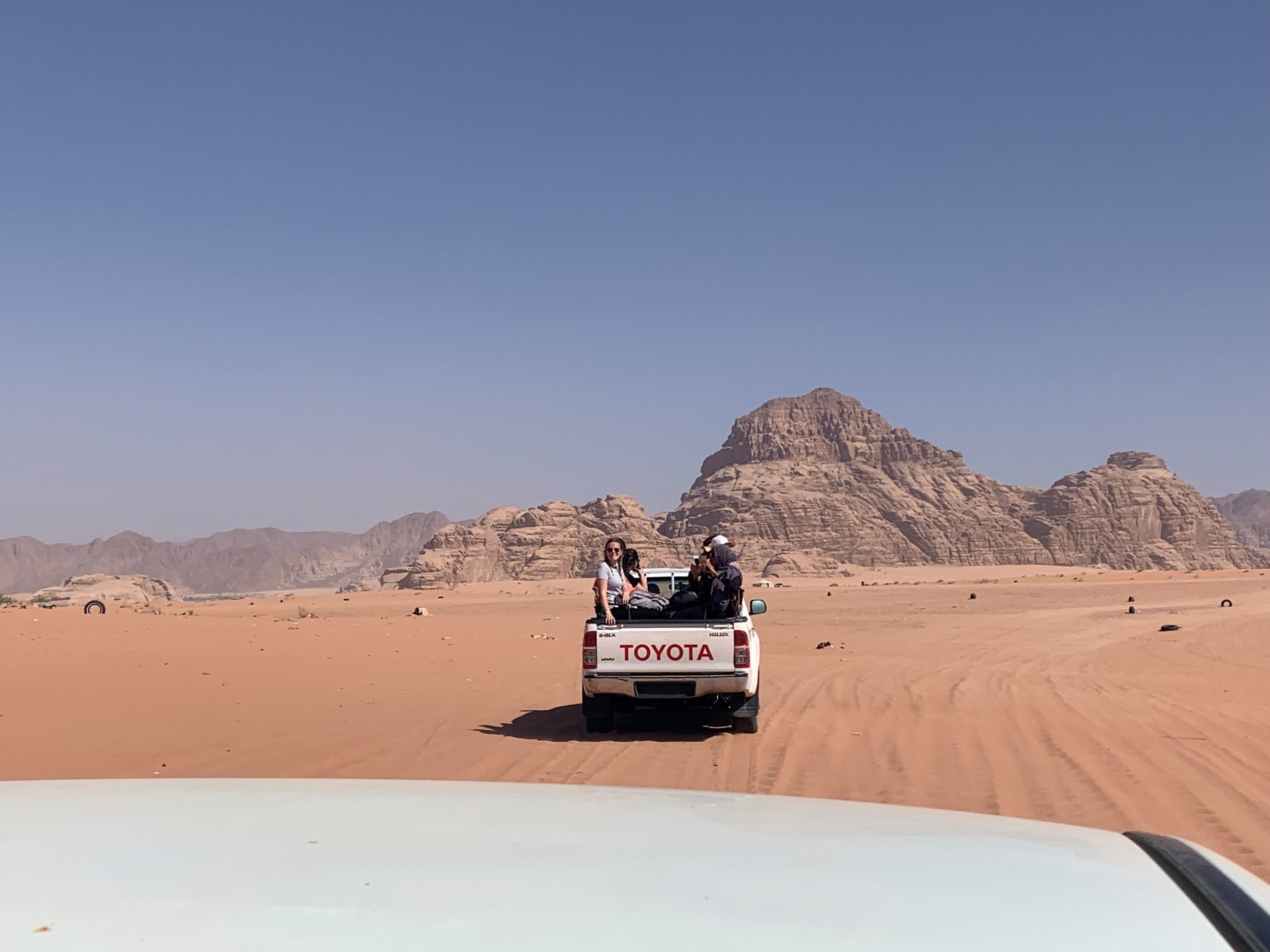 Our Jeep tour of Wadi Rum, we all hoped to race each other and see who could be faster! While on the jeep tour, we saw ancient rock carvings and messages, met with local bedouins, and saw the beauty that is Wadi Rum. Photo credit: Russo, 2019