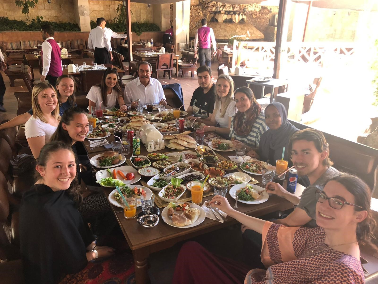 After our Conflict & the Struggle for Peace program portion of classes in Amman, our professor Dr. Omar Rifai took us all out for a traditional Jordanian meal. Photo credit: Russo, 2019