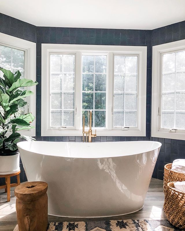 Thought I would share a few more pictures of the bathroom!  One of my favorite features in this space is the bathtub. It took a little while to find the perfect one but it was worth the search! The freestanding soaker tub is the evanescence by @BainUltra. It is definitely made for soaking with its gently curved silhouette and tall sides.  The amazing floor mounted tub filler is  by @newportbrass.  This one is from the East Linear line and the finish is antique brass.  And I definitely need to mention the tiles.  The feature wall was tiled floor to ceiling with Disel Camp Blue Rock tiles from @tilebar.  Love it!  Thank you again to @cha_lee_wstson for your great work on this project!  And @samanthawstsonphotography for the beautiful photos! Thank you Sam!