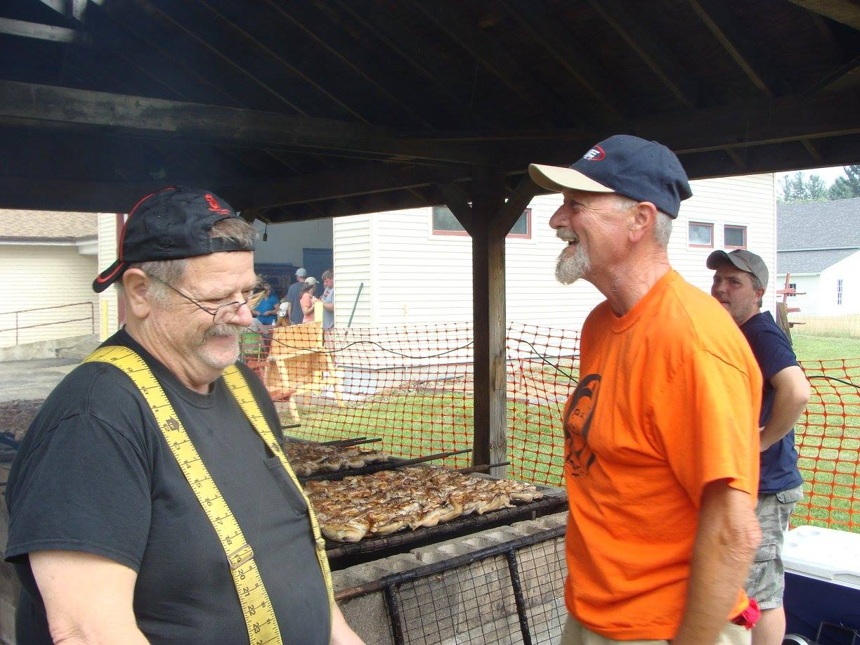Fire Department members enjoying the company of locals at the annual Field Day