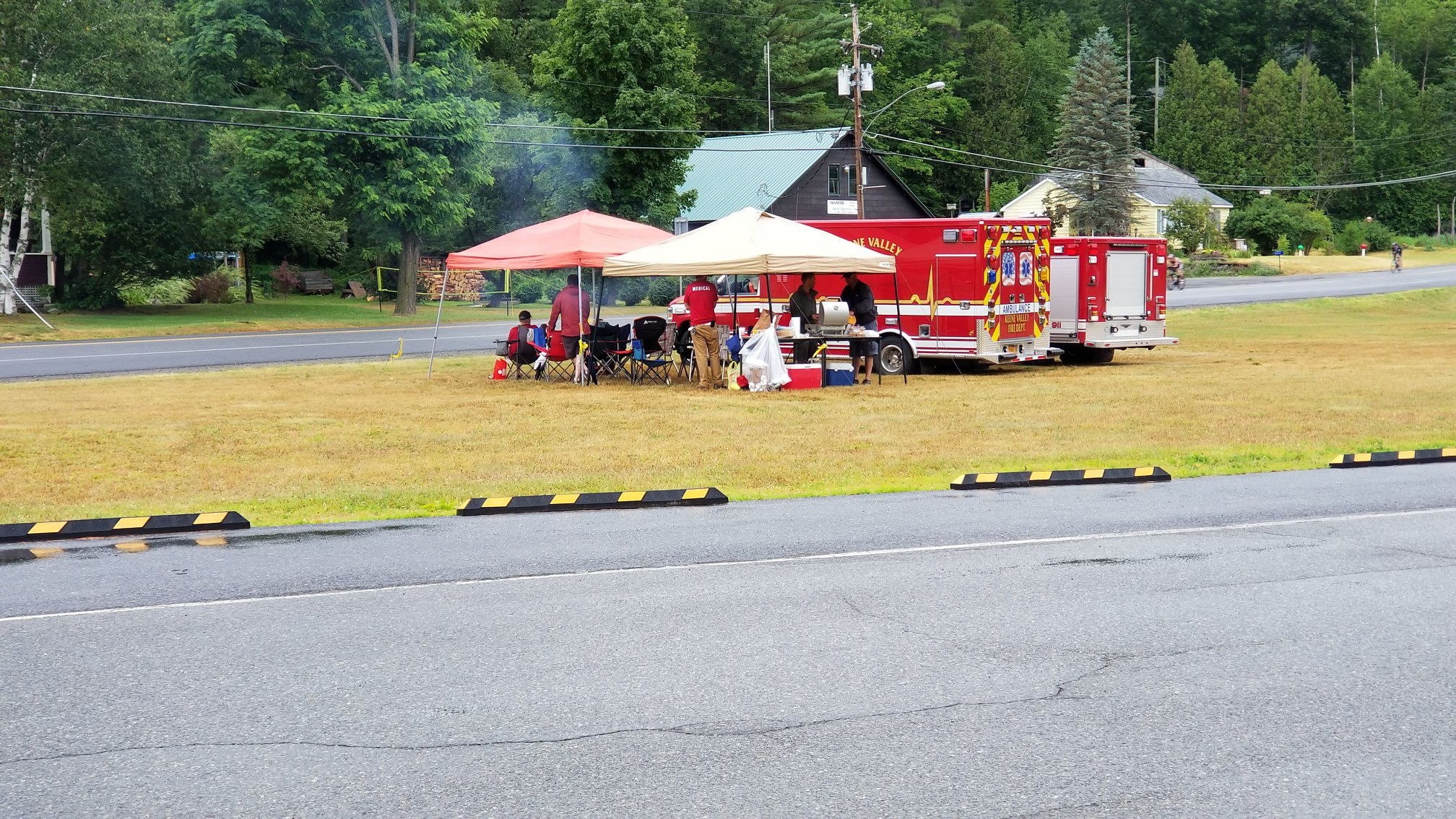 EMT's volunteer at a station for the Ironman Race