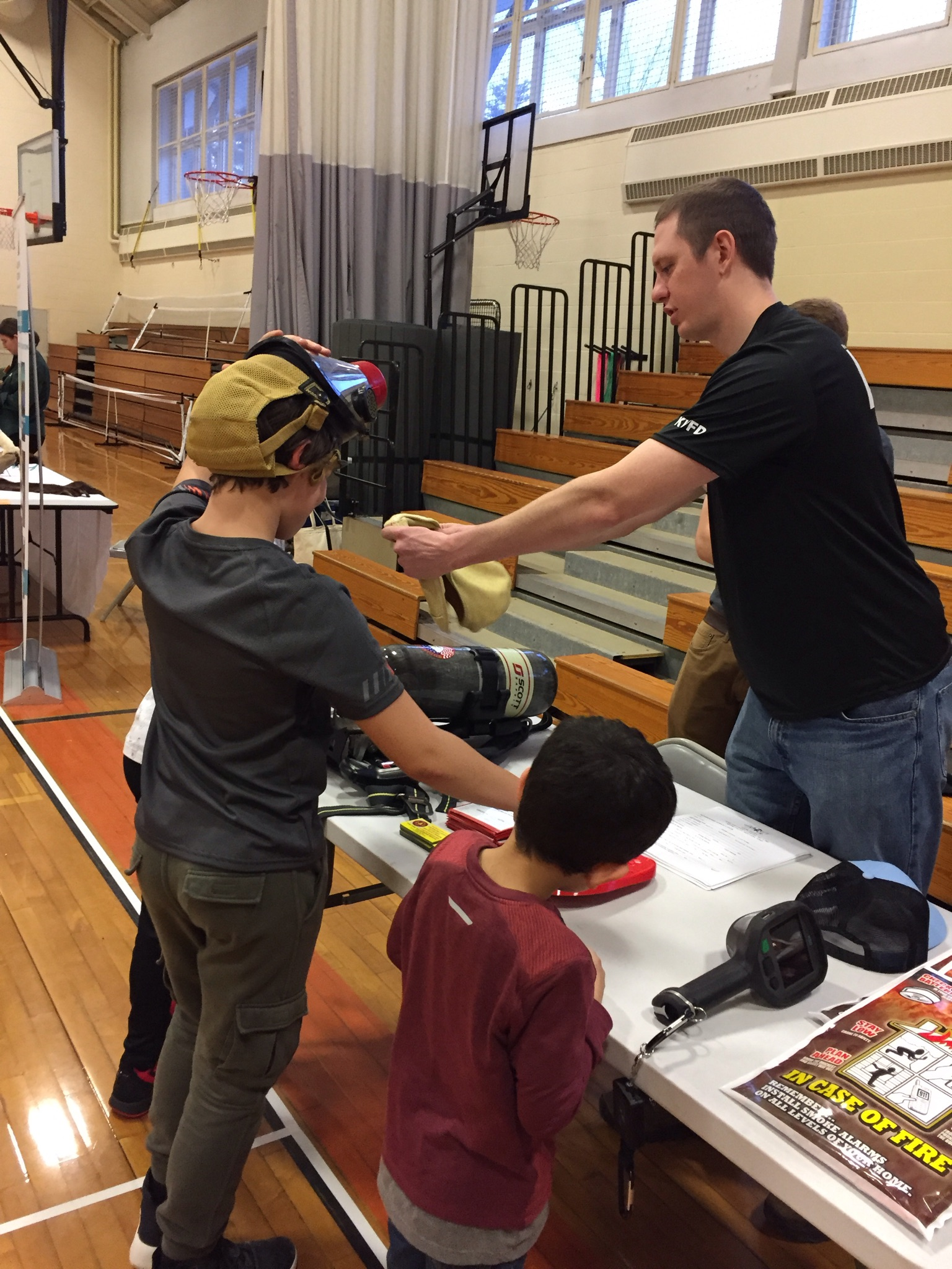 Members participate in the local school's Science Slam Event