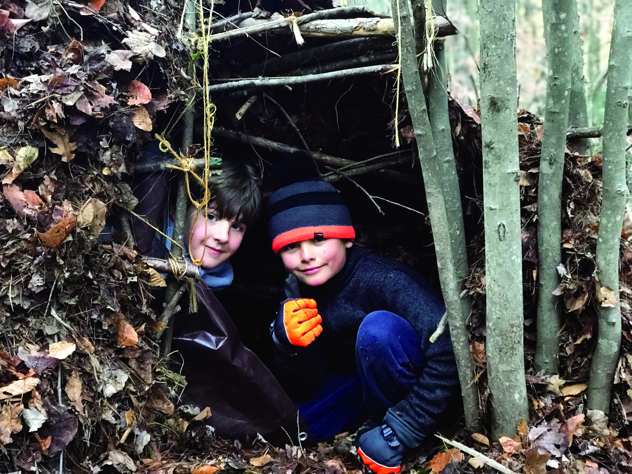 Fifth graders Robbie and Teo in their shelter