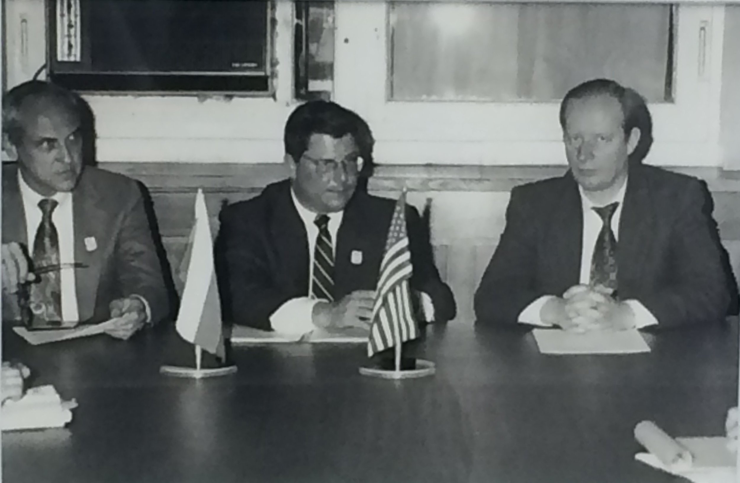 Stanford economist Charles McLure (right) joined Dan Witt (center) and Russian Deputy Finance Minister Sergey Gorbachev (left) to sign the Memorandum of Understanding in Moscow in March 1993.