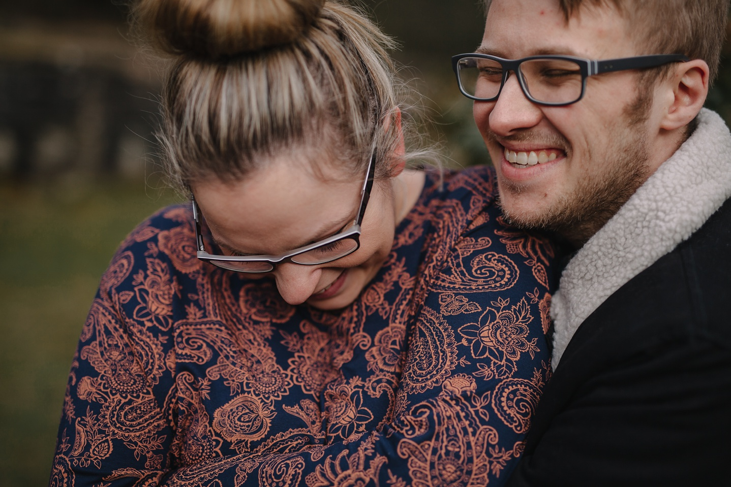 close up of man and woman laughing