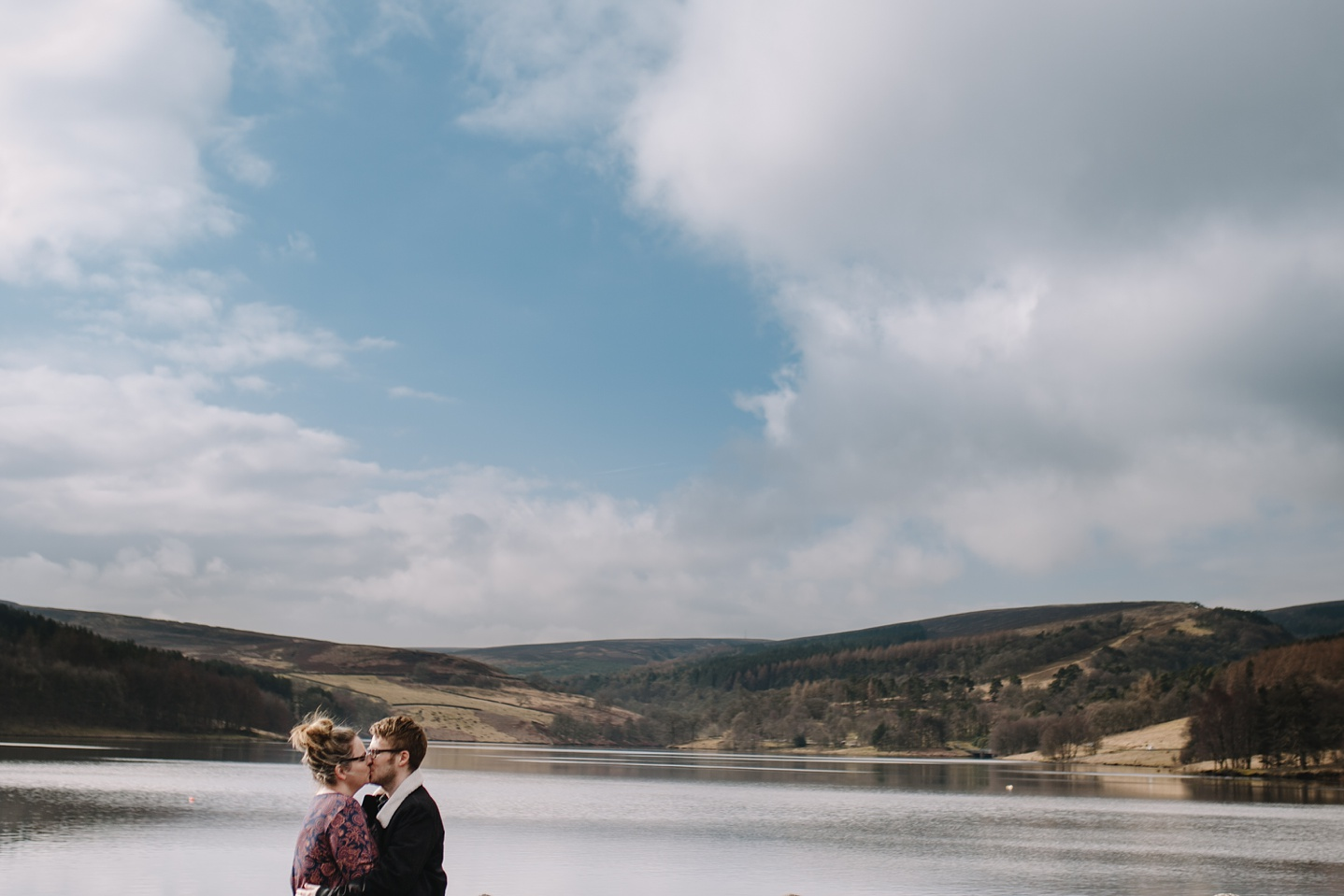 man and woman laughing with Eerwood reservoir in the background