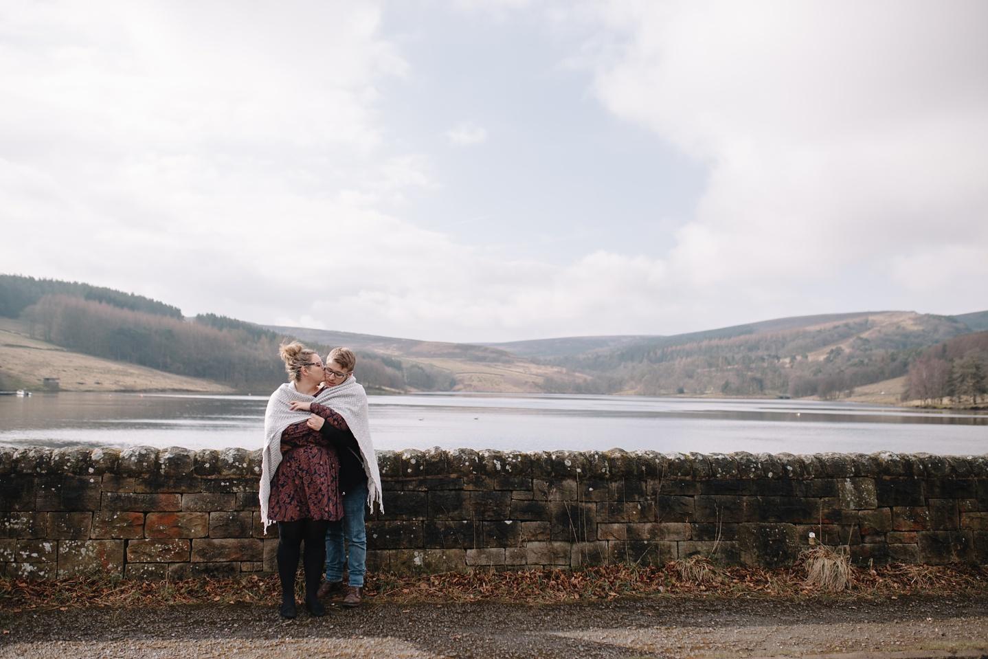 man and woman stood overlooking errwood reservoir