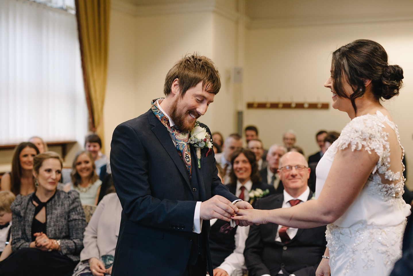 bride and groom exchanging wedding rings at Sheffield Town Hall Wedding