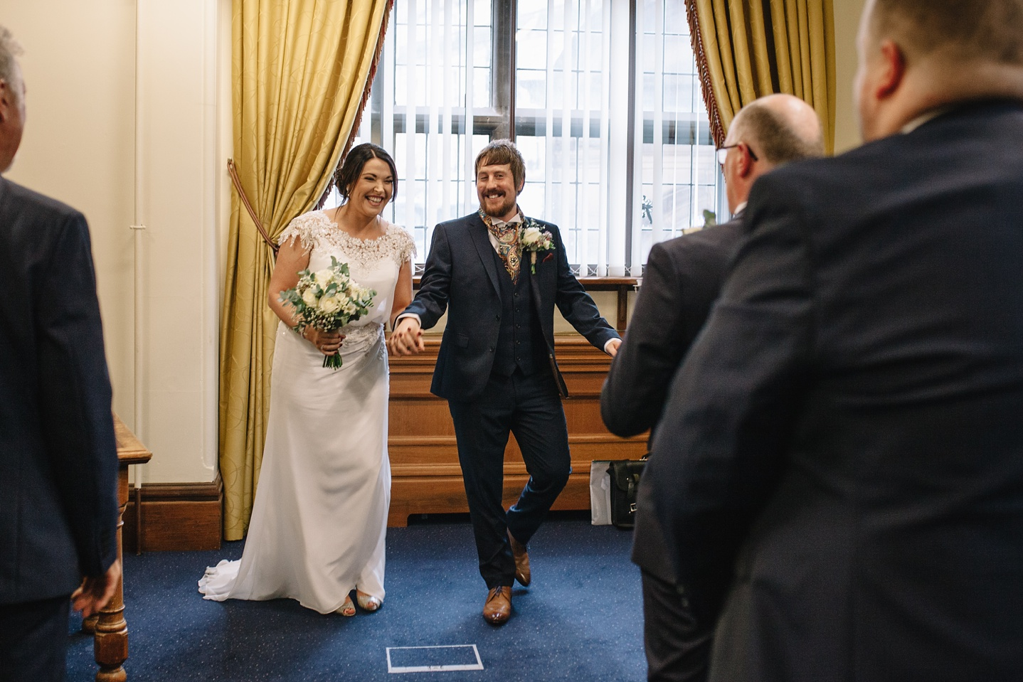 Bride and groom walking down the aisle at Sheffield Town Hall