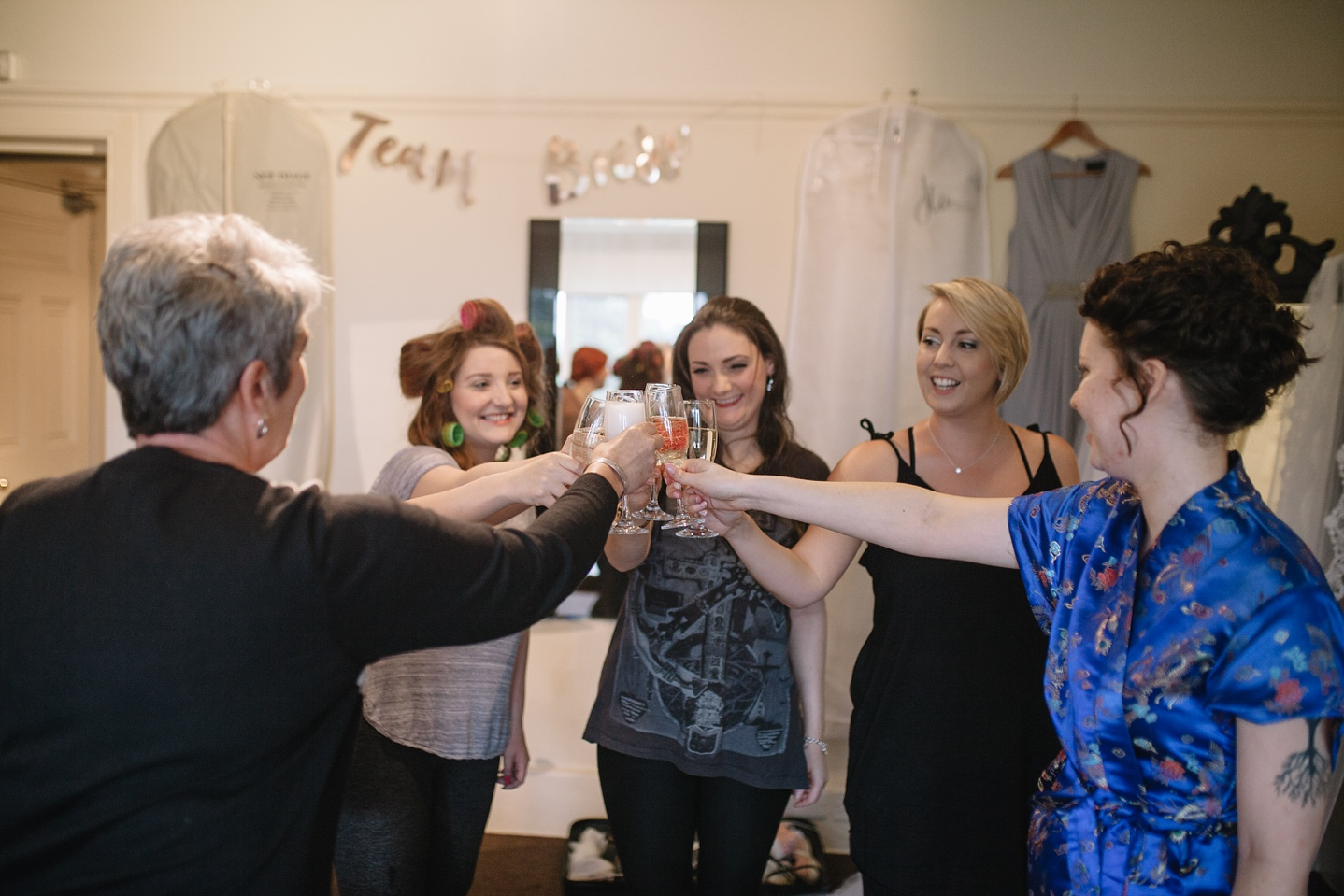 bridal party toasting during bridal preporations
