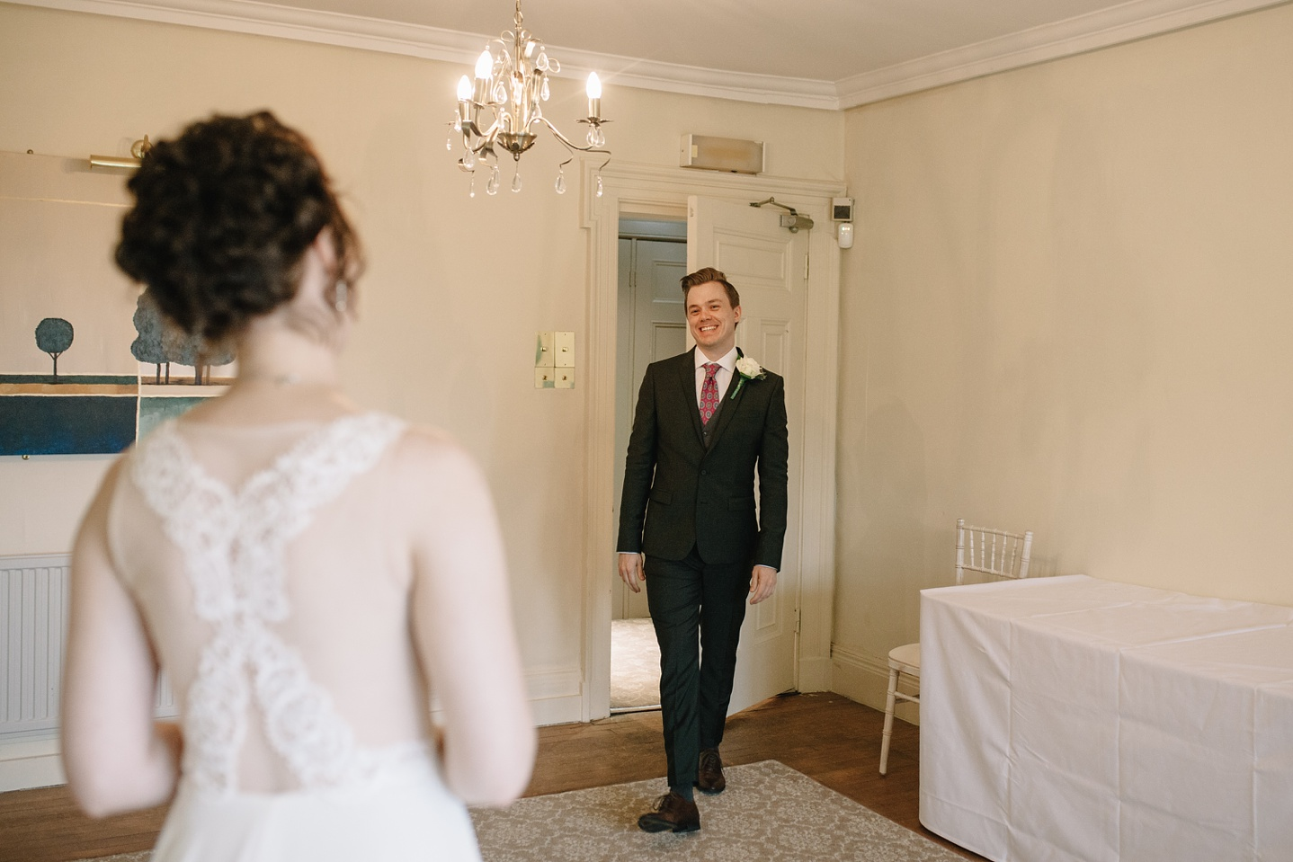 grooms reaction to the first look of his beautiful bride