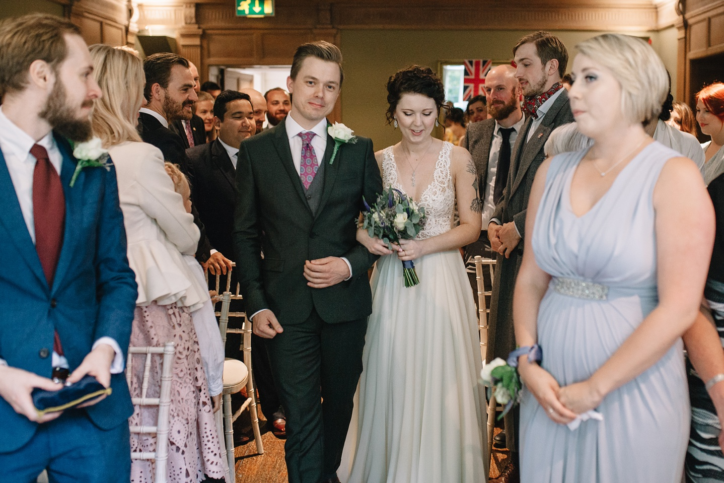 bride and groom walking down the aisle together for the start of the ceremony at Whirlowbrook Hall