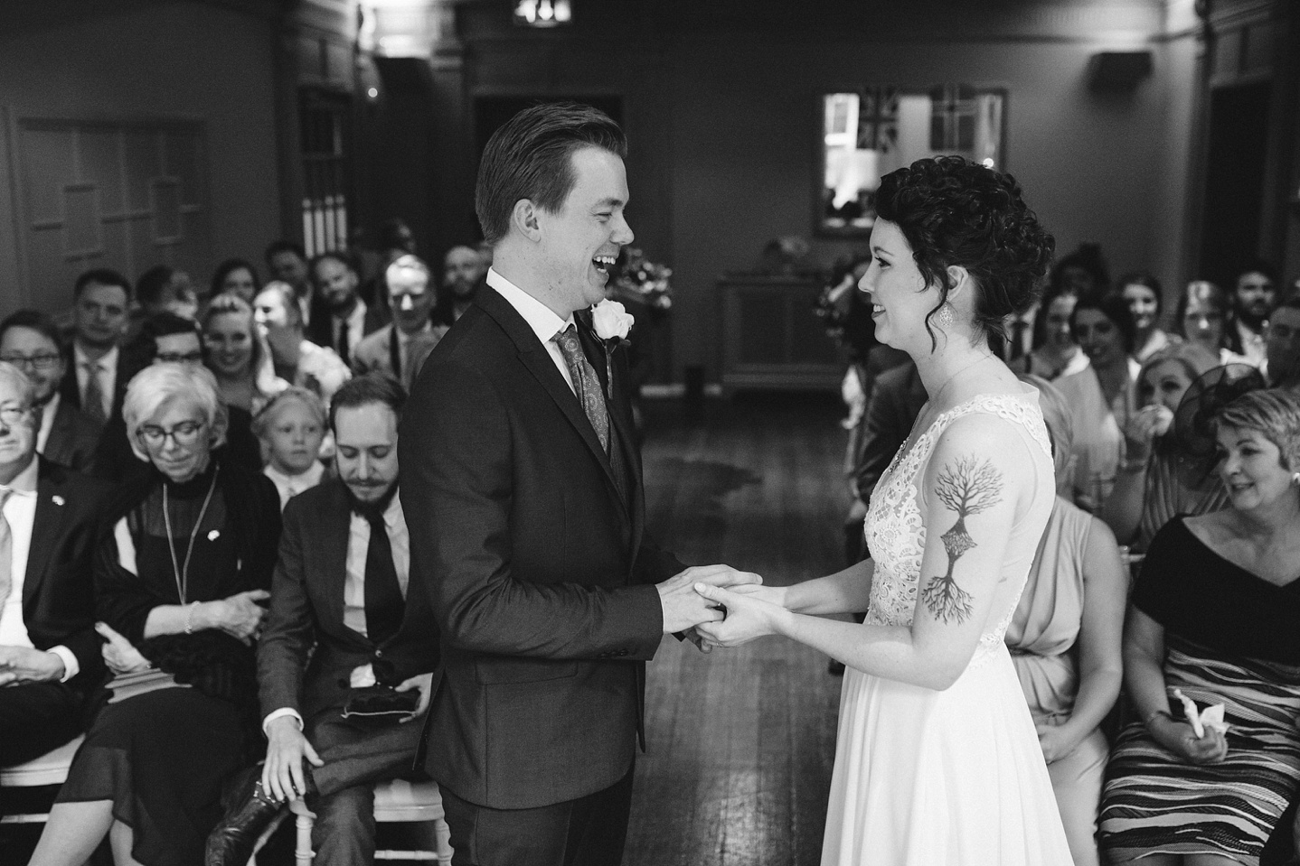 Bride and groom exchanging wedding rings at Whirlowbrook Hall