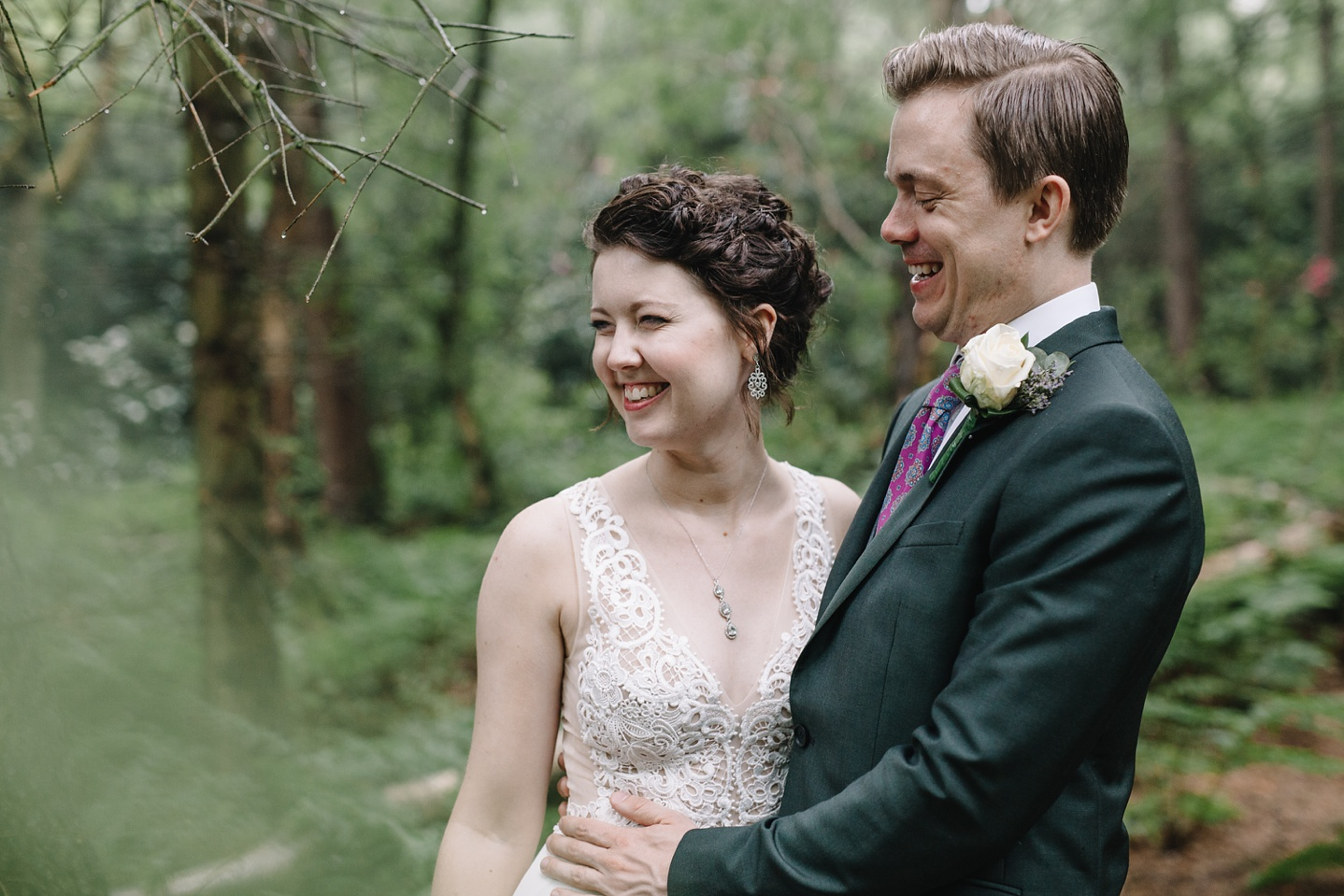 close up of bride and groom laughing in the woods at Whirlowbrook Hall