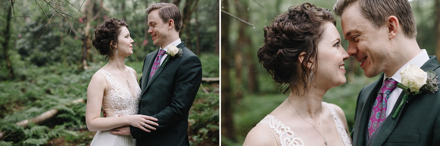 bride and groom smiling in the woods