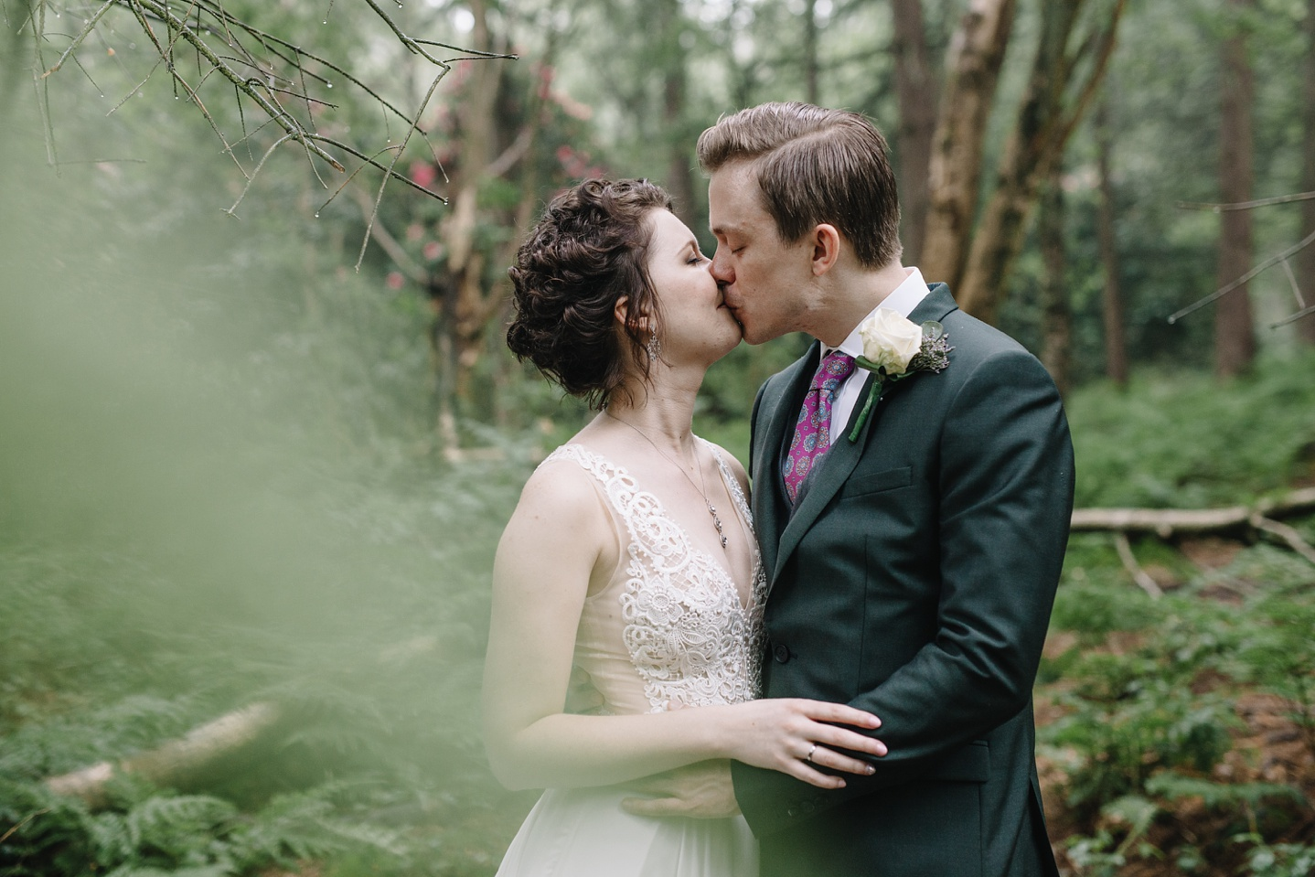 close up of bride and groom kissing at Whirlowbrook Hall woods