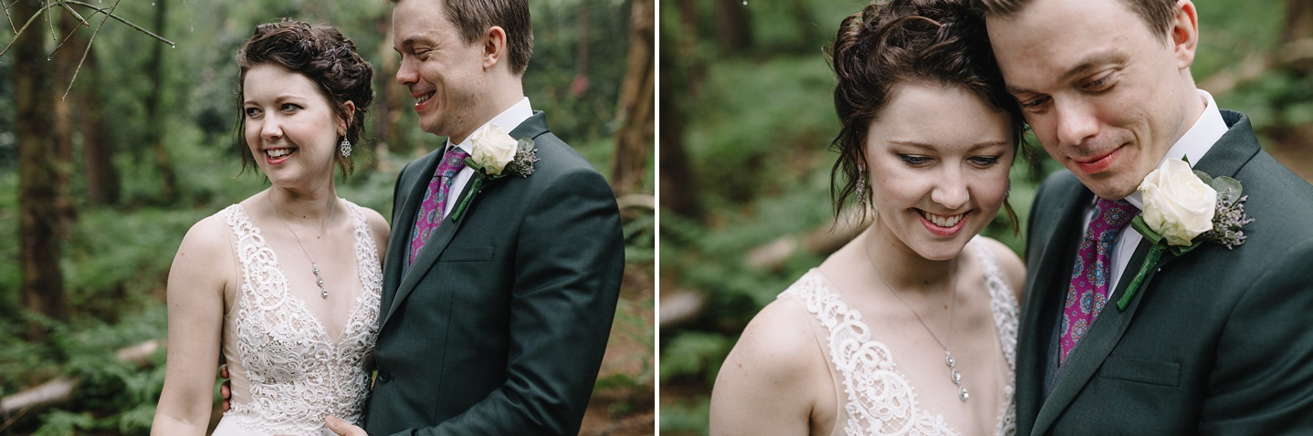 bride and groom laughing and smiling in the woods